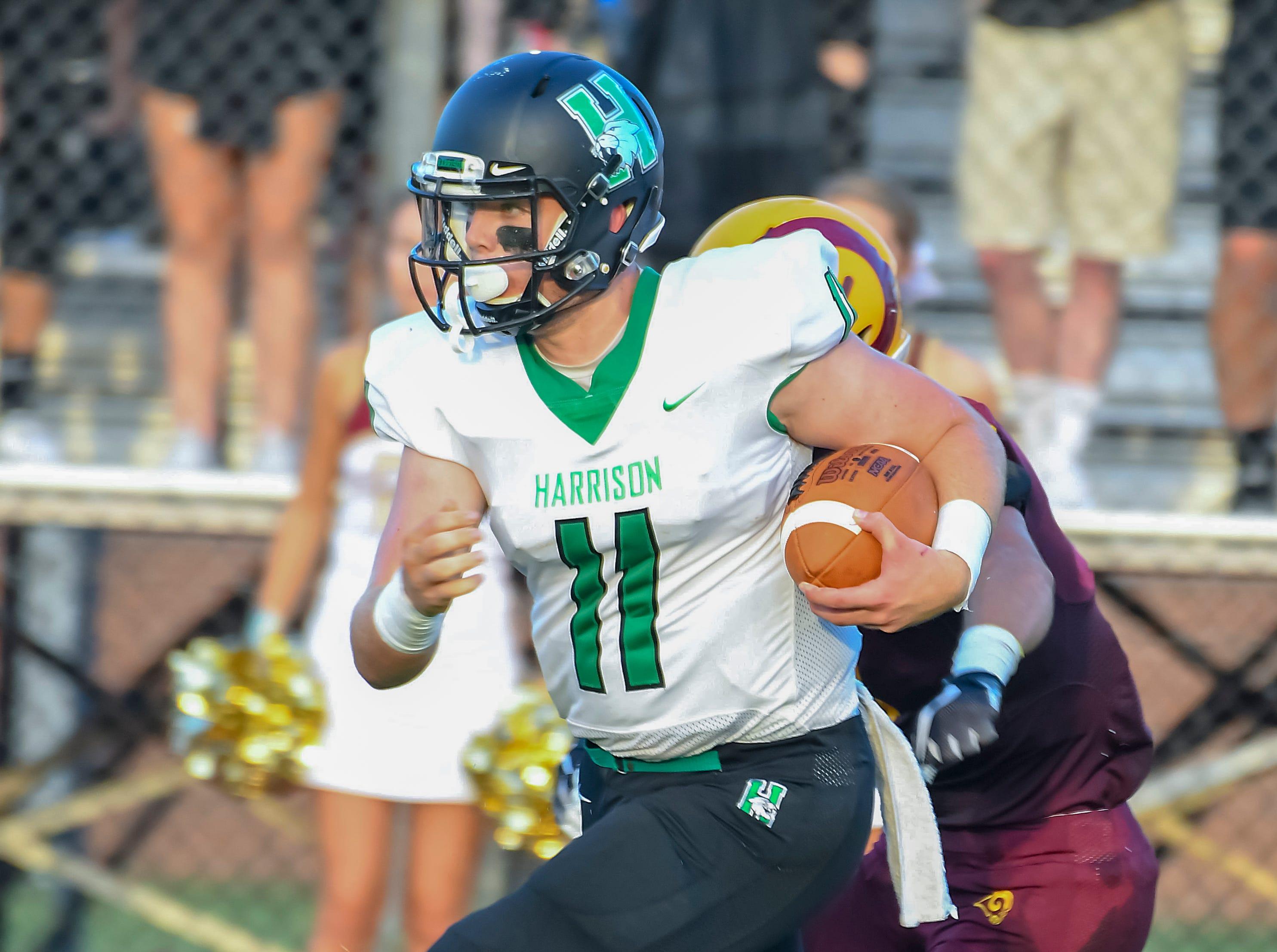 Connor Kinnett of Harrison runs the ball against Ross, Ross High School, Friday, September 14, 2018