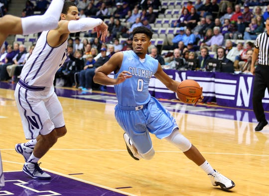 Nov 20, 2015; Evanston, IL, USA; Columbia Lions guard Kyle Castlin (0) drives around Northwestern Wildcats forward Joey van Zegeren (1) during the first half of the game at Welsh-Ryan Arena.