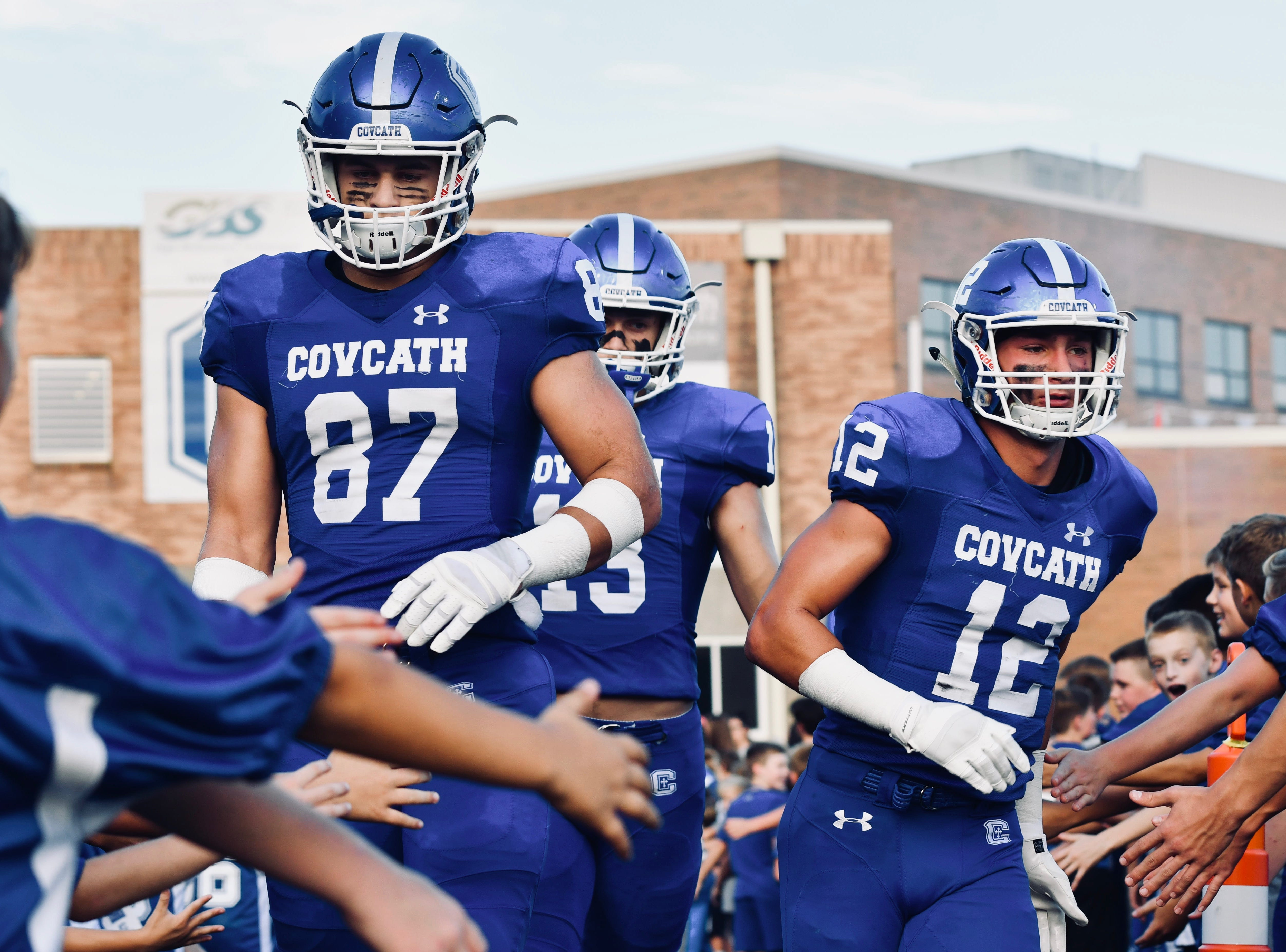 The Covington Catholic captains Michael Mayerm, Jack Coldiron and Tyler Reusch take the field prior to kickoff against Beechwood Friday, Sept. 14, 2018.