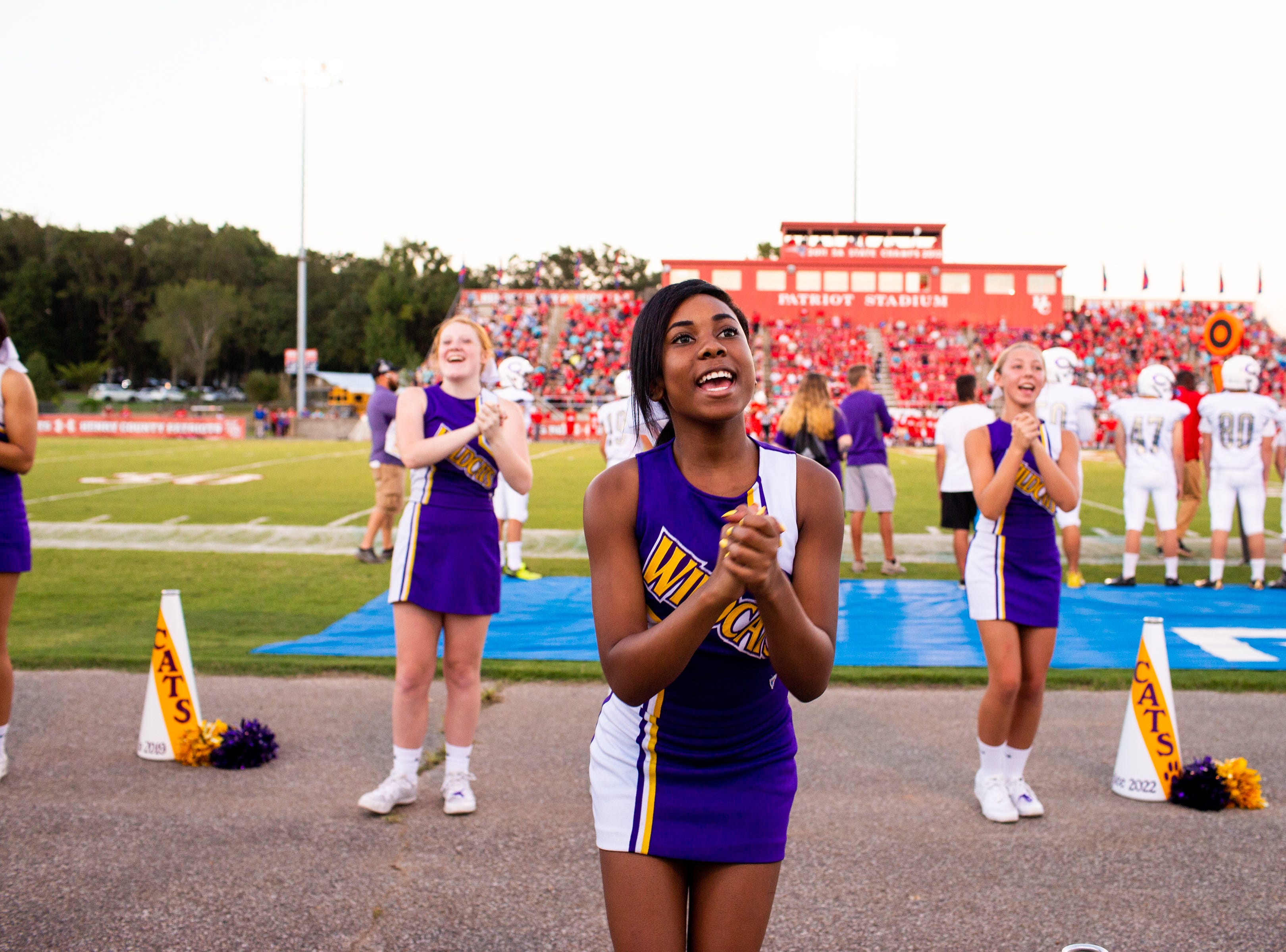 Clarksville High cheerleaders fire up the crowd during the first half at Henry County Friday, Sept. 14, 2018, in Paris, Tenn.