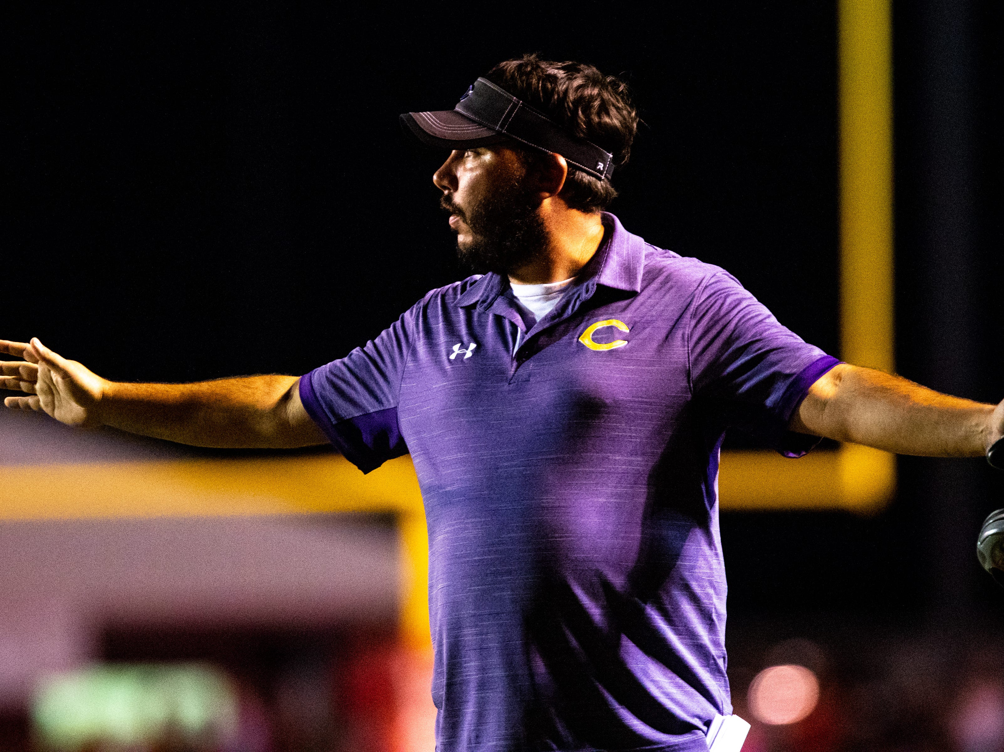 Clarksville High head coach Isaac Shelby watches the game during the second half at Henry County Friday, Sept. 14, 2018, in Paris, Tenn.