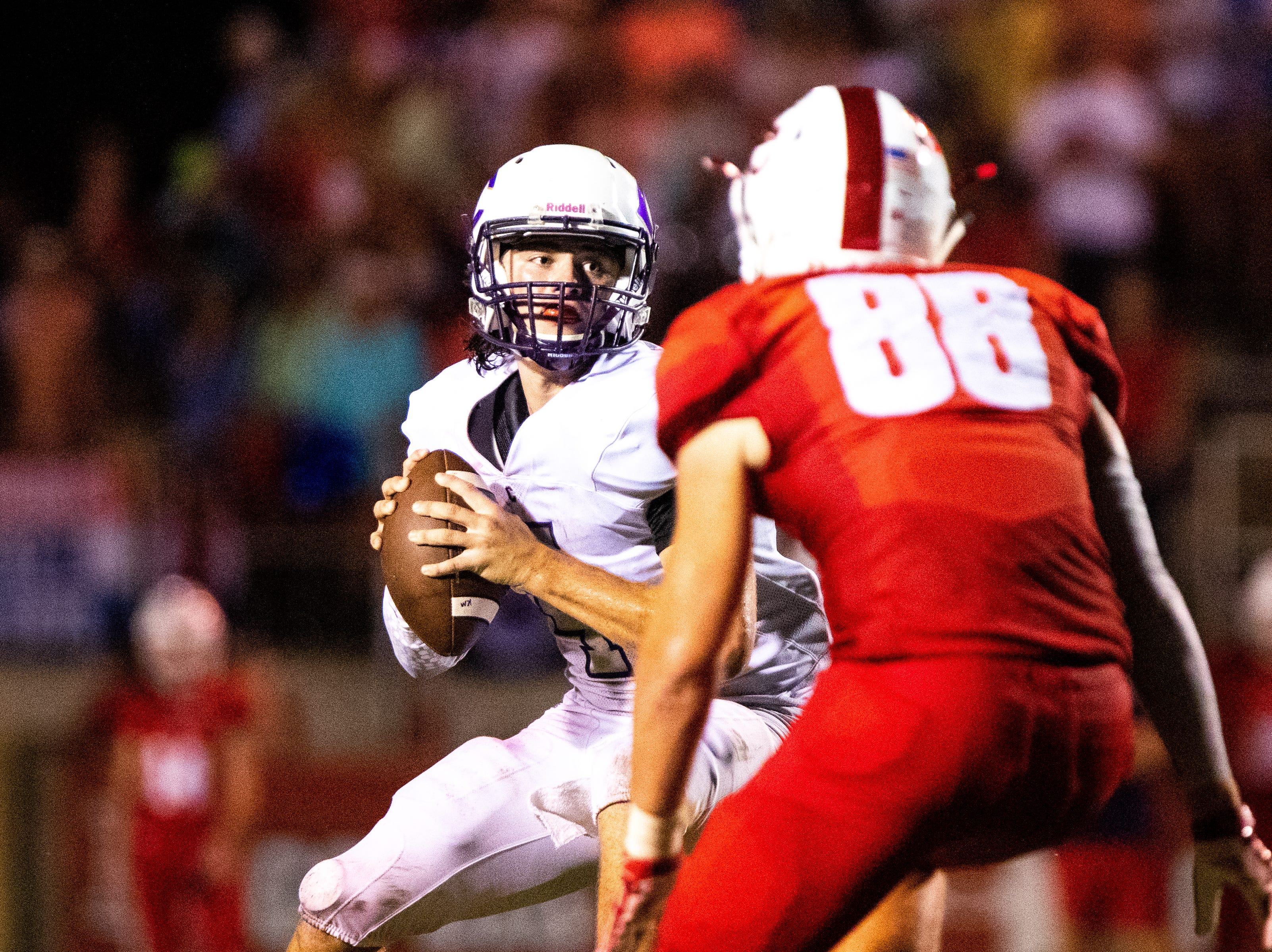 Ford Cooper (4) of Clarksville High looks to throw the ball during the first half at Henry County Friday, Sept. 14, 2018, in Paris, Tenn.