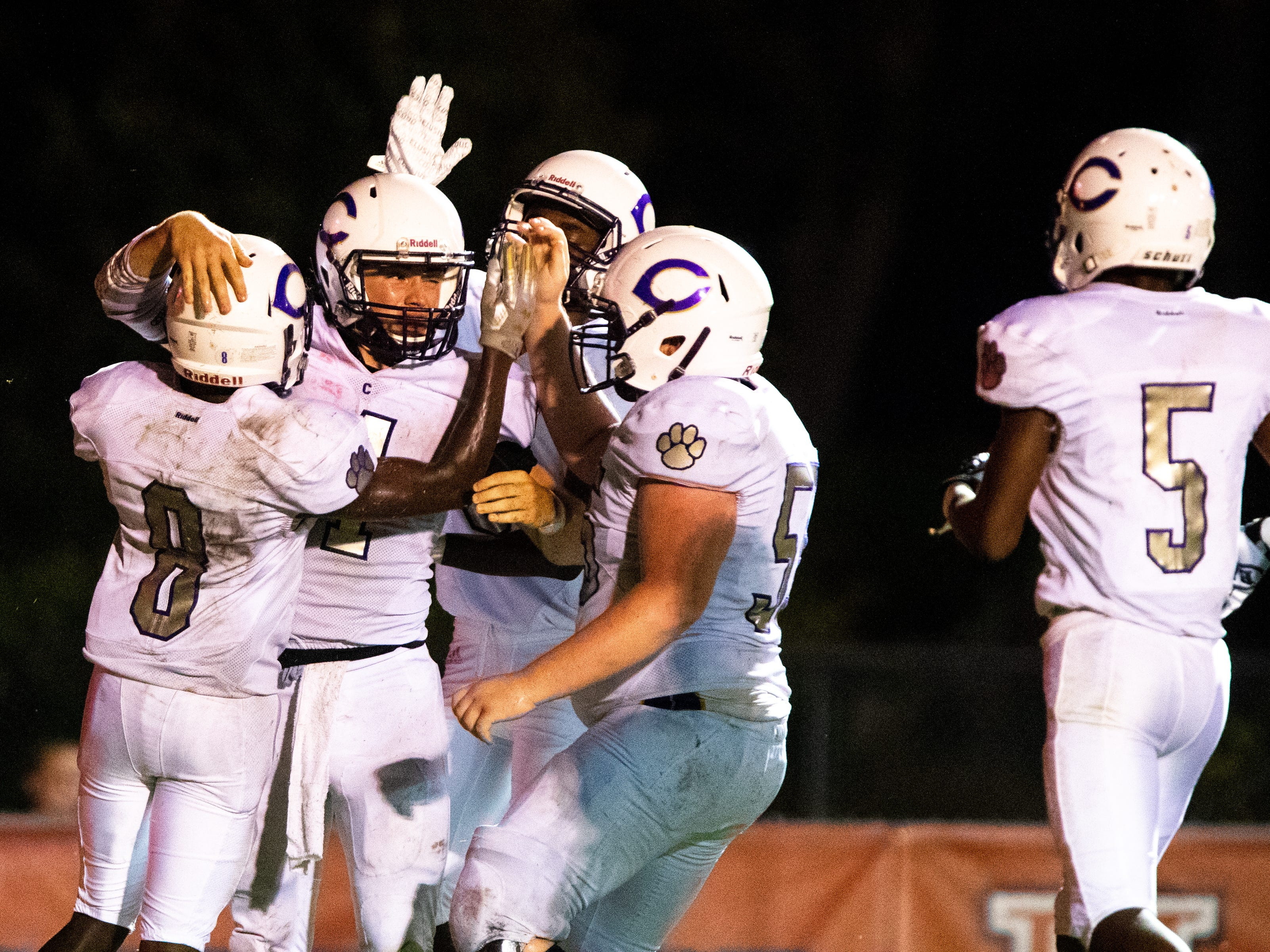 Ford Cooper (4) of Clarksville High is celebrated after his touchdown during the second half at Henry County Friday, Sept. 14, 2018, in Paris, Tenn.