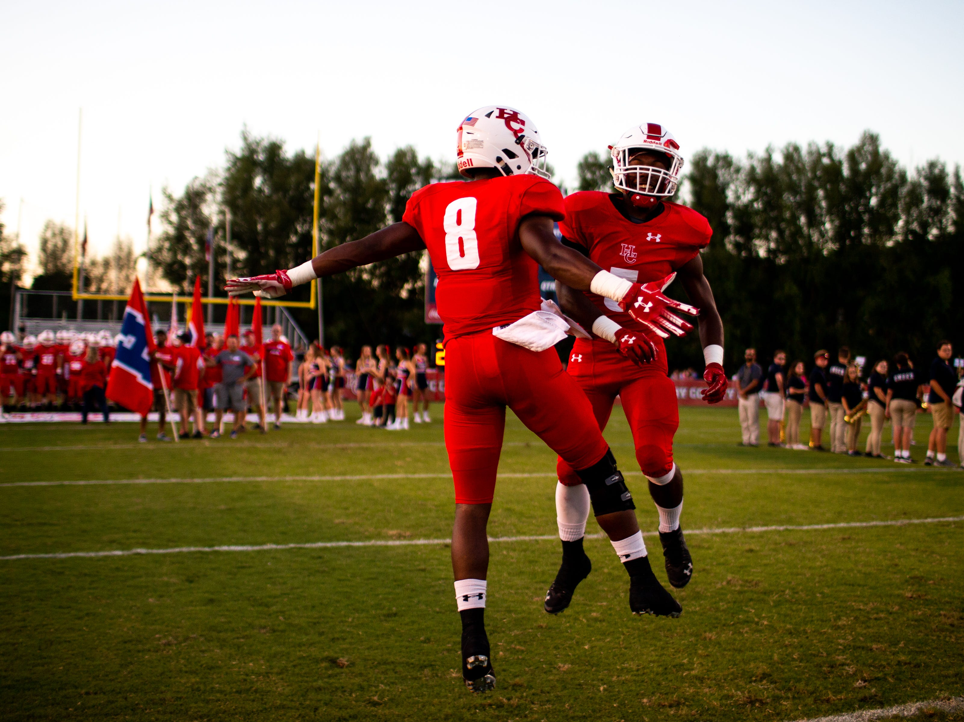 Joseph Travis (8) and Jayln Foster (5) of Henry County greet each other before the first half at Henry County Friday, Sept. 14, 2018, in Paris, Tenn.