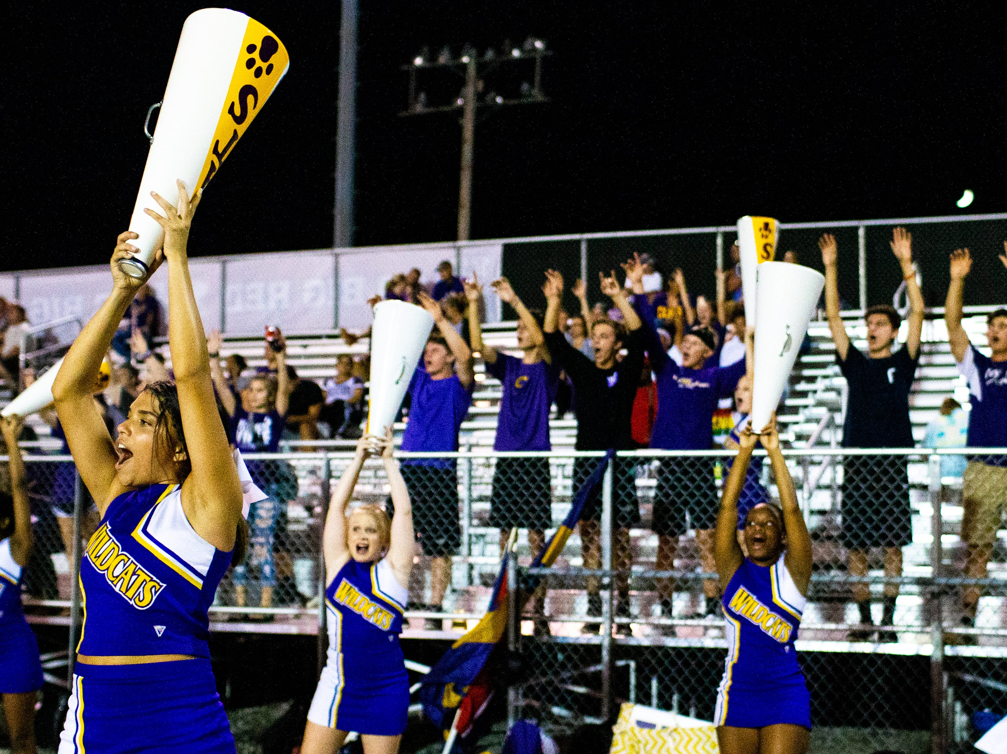 Clarksville High cheerleaders fire up the crowd during the second half at Henry County Friday, Sept. 14, 2018, in Paris, Tenn.