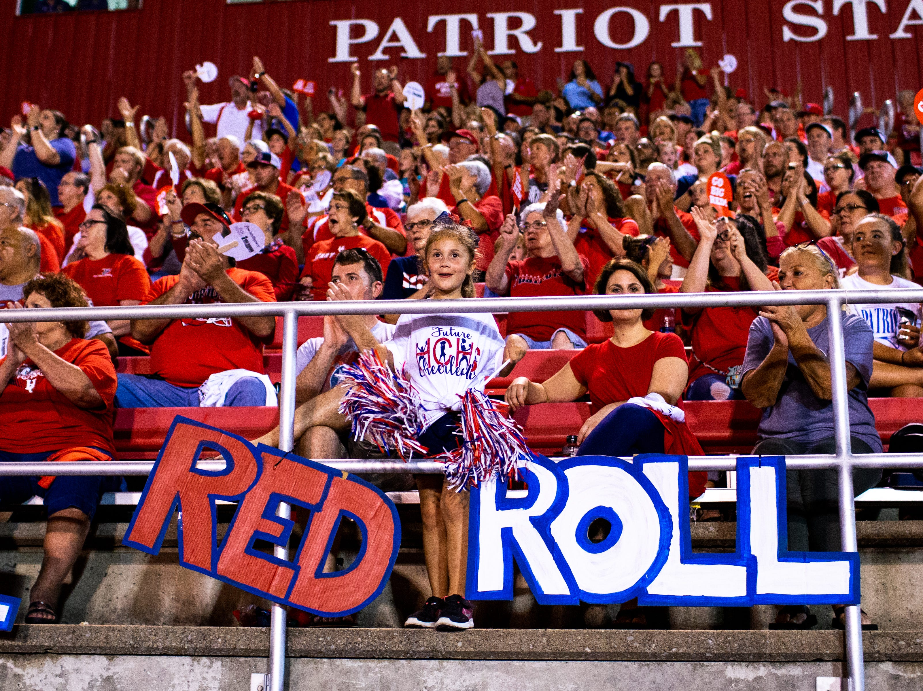 Fans cheer for Henry County during the first half at Henry County Friday, Sept. 14, 2018, in Paris, Tenn.