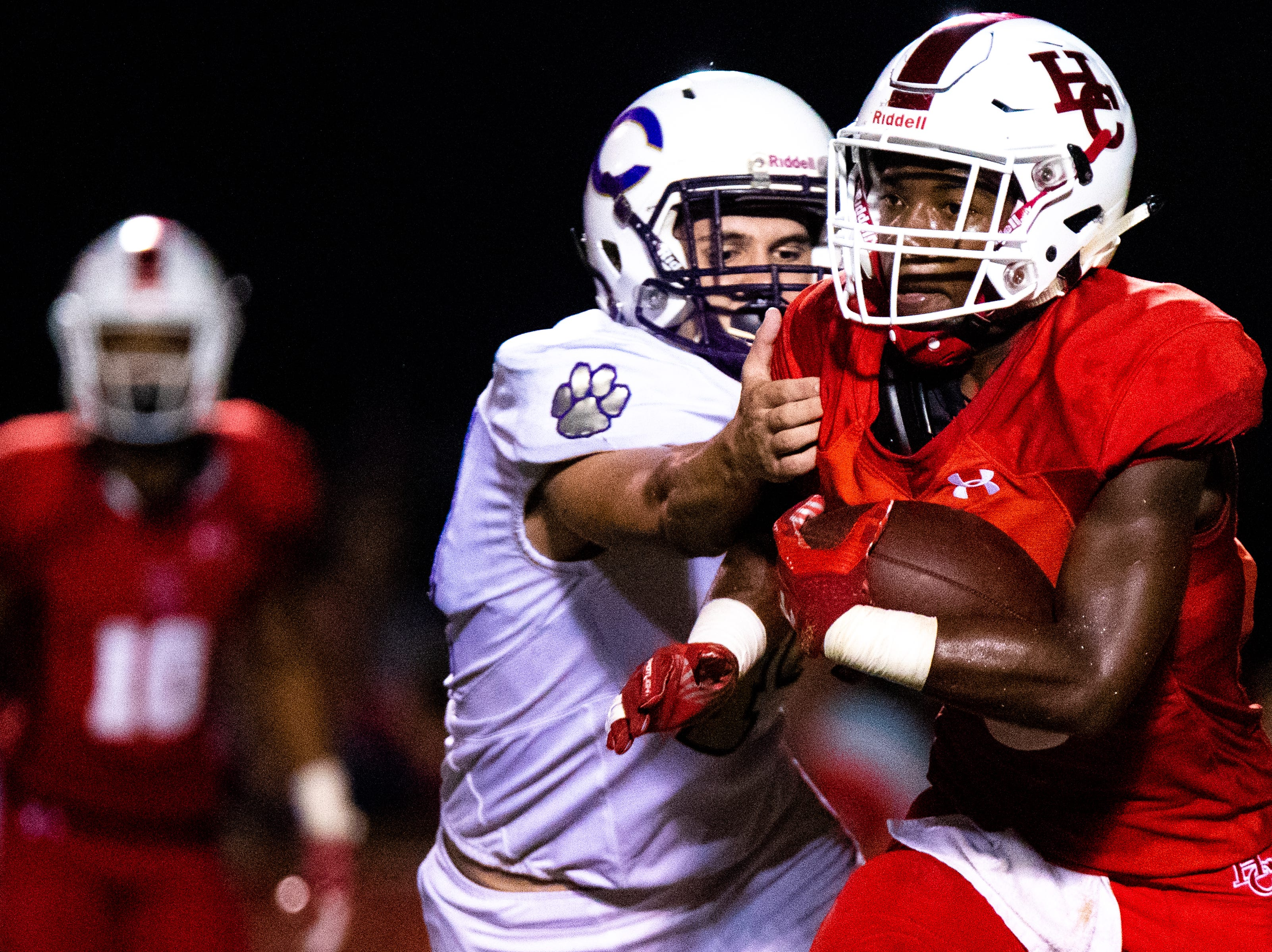 Jayln Foster (5) of Henry County runs the ball during the first half at Henry County Friday, Sept. 14, 2018, in Paris, Tenn.