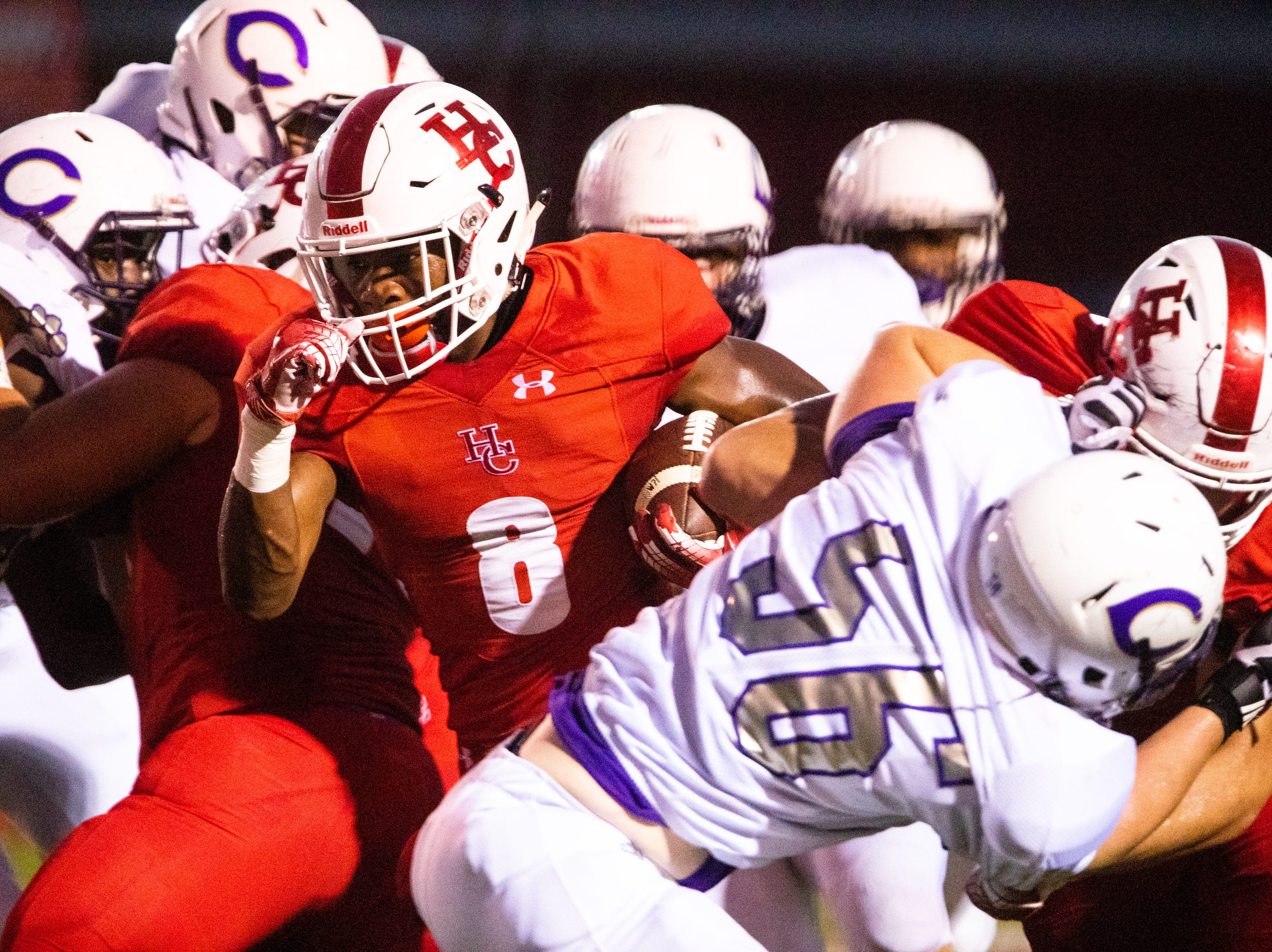 Joseph Travis (8) of Henry County runs the ball during the first half at Henry County Friday, Sept. 14, 2018, in Paris, Tenn.