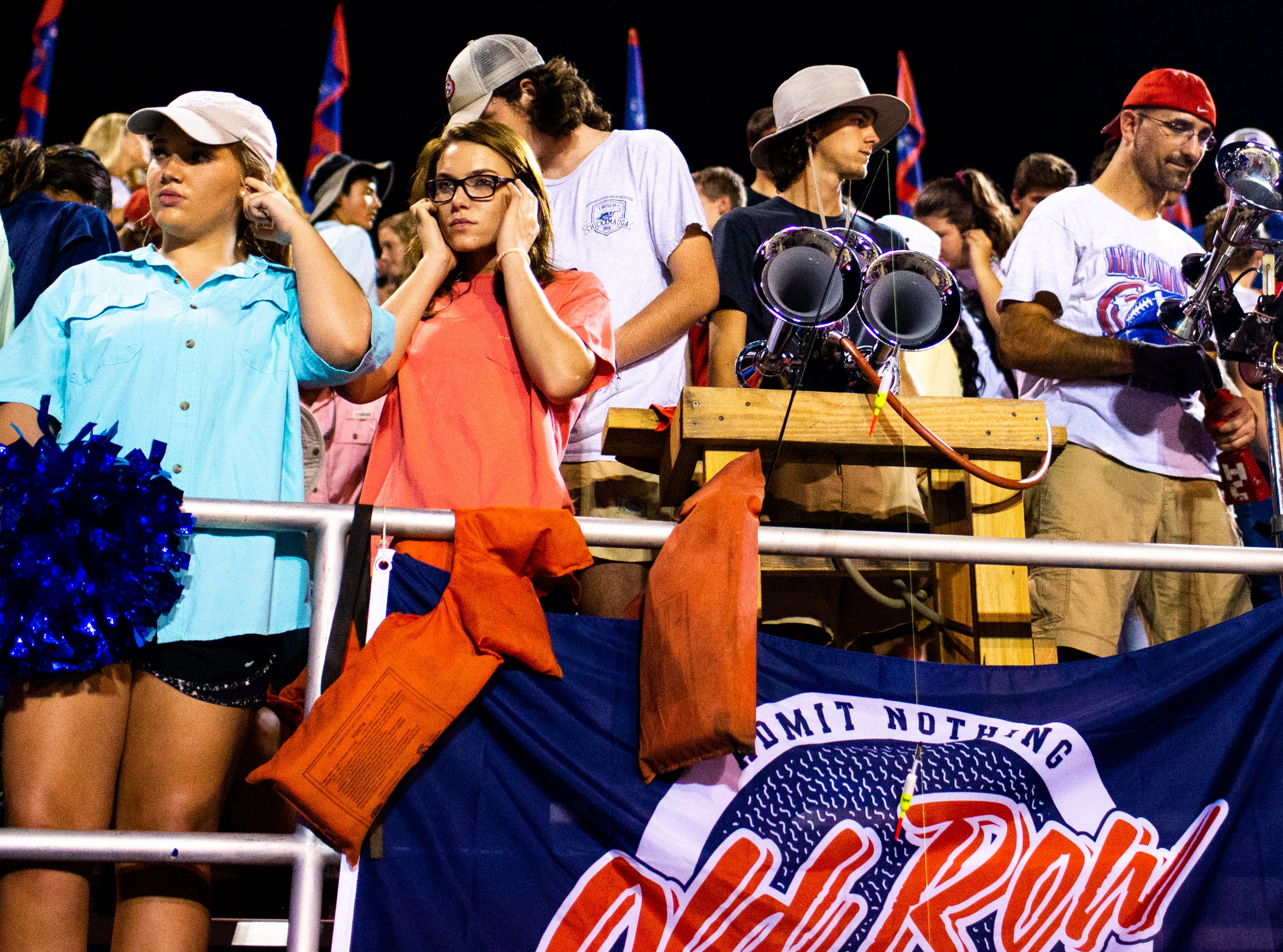 Henry County students plug their ears as they set off the alarm during the first half at Henry County Friday, Sept. 14, 2018, in Paris, Tenn.