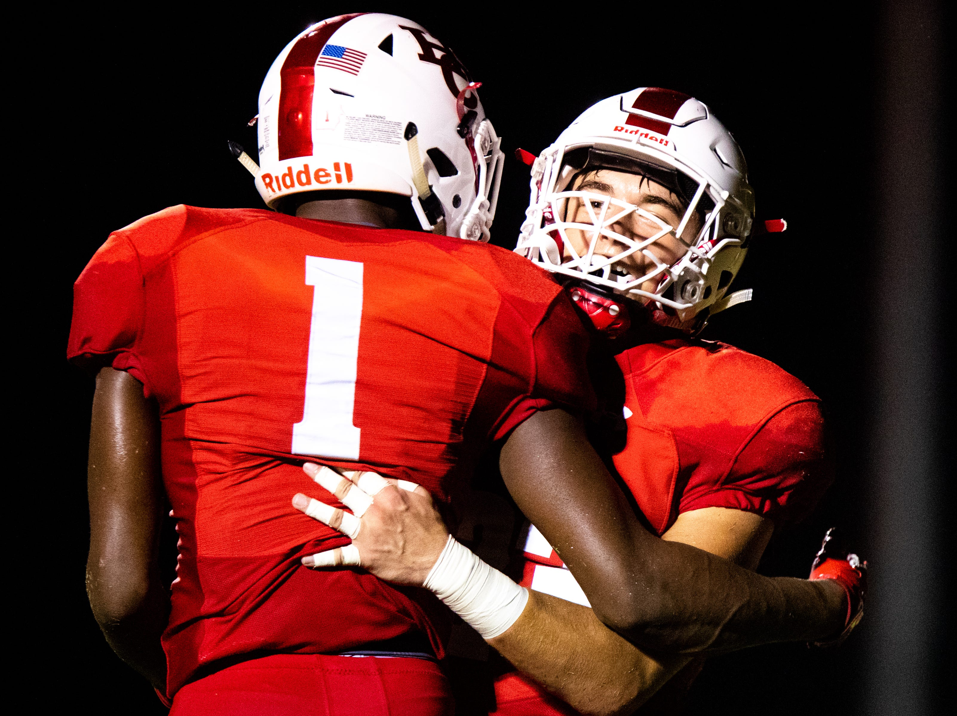 Gavin Gordon (23) and Jawon Odoms (1) of Henry County celebrate after Clarksville High's fourth down during the first half at Henry County Friday, Sept. 14, 2018, in Paris, Tenn.