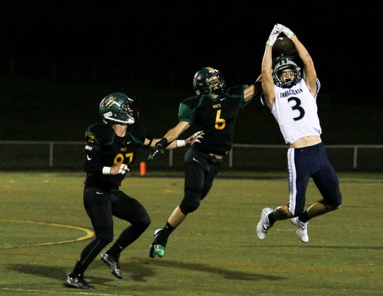Immaculata's Matthew DiPietro jumps for the pass during the first half of a football game at North Hunterdon High School on September 14, 2018.    Alexandra Pais/ for the Courier News