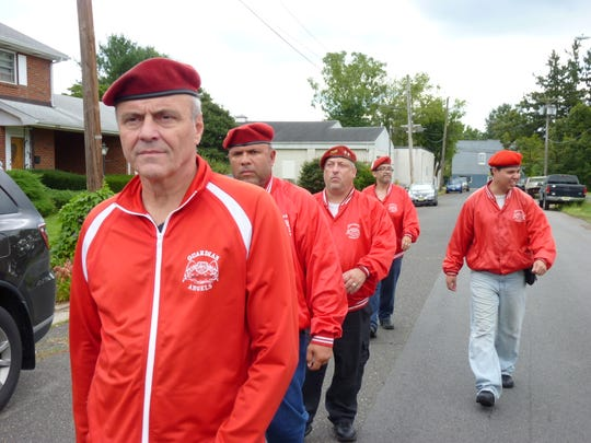 Curtis Sliwa leads a group of Guardian Angels in Manville.