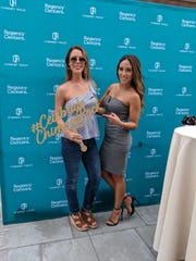 "Melissa Gorga, right, star of ""The Real Housewives of New Jersey,"" is pictured with Regency Centers' Assistant Marketing & Events Manager Stephanie Parisi at the Sept. 15 grand opening of Chimney Rock Crossing in Bridgewater."