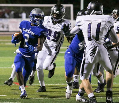 Sayreville's Jacari Carter runs the ball as Old Bridge defends during the first half of on Nov. 03, 2017.