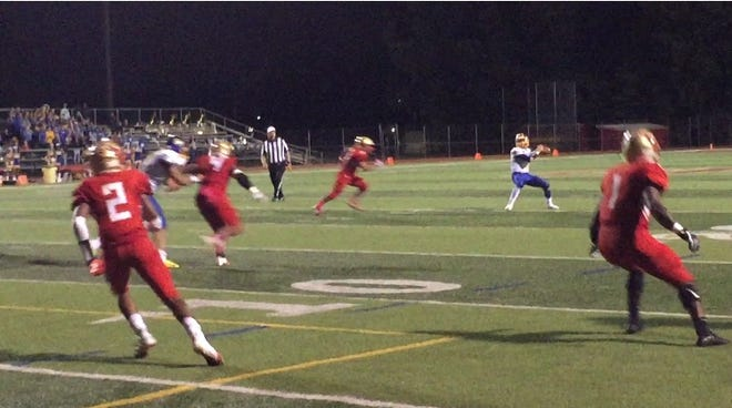 Christian Petrillo throws a touchdown pass for North Brunswick on Friday night.