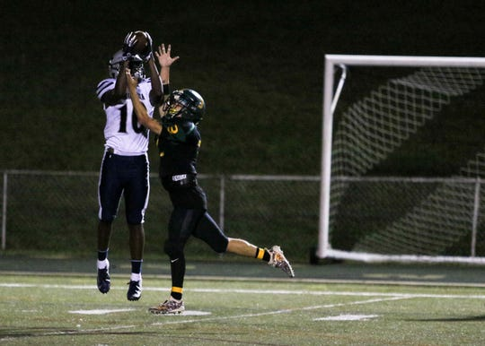 Immaculata's Pelton Esannason intercepts a pass during the first half of a football game at North Hunterdon High School on September 14, 2018.    Alexandra Pais/ for the Courier News