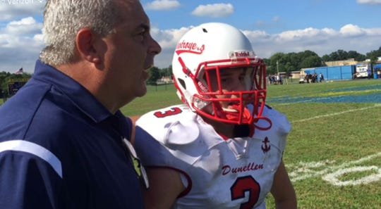 Dunellen coach Dave DeNapoli talks with quarterback Noah Wenzel.