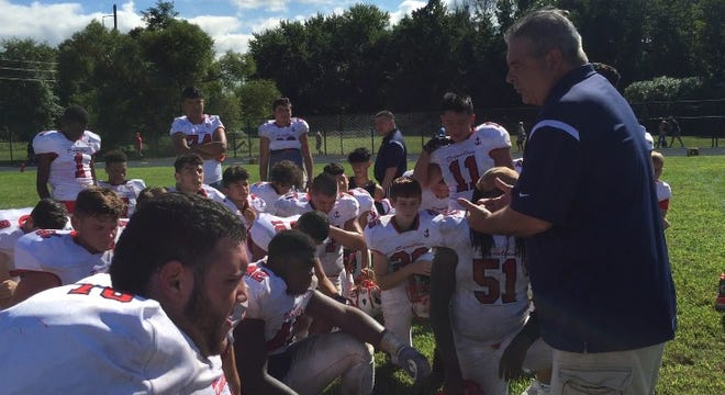Dave DeNapoli talks to his players following Dunellen's 44-20 win over Spotswood on Saturday