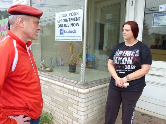 Curtis Sliwa speaking with an employee of Wonderful Pets Grooming in Manville.