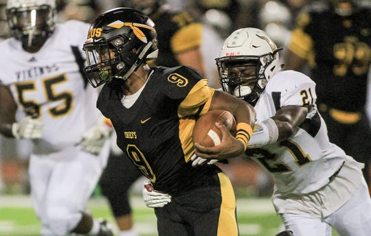 Piscataway's Juwon Jackson (left) slips from the grasp of South Brunswick's Khristian Hernandez on Sept. 14, 2018 at Piscataway.