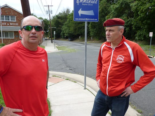Manville Councilman Joe Lukac, left, and Guardian Angels founder Curtis Sliwa, right, on South Street in Manville.
