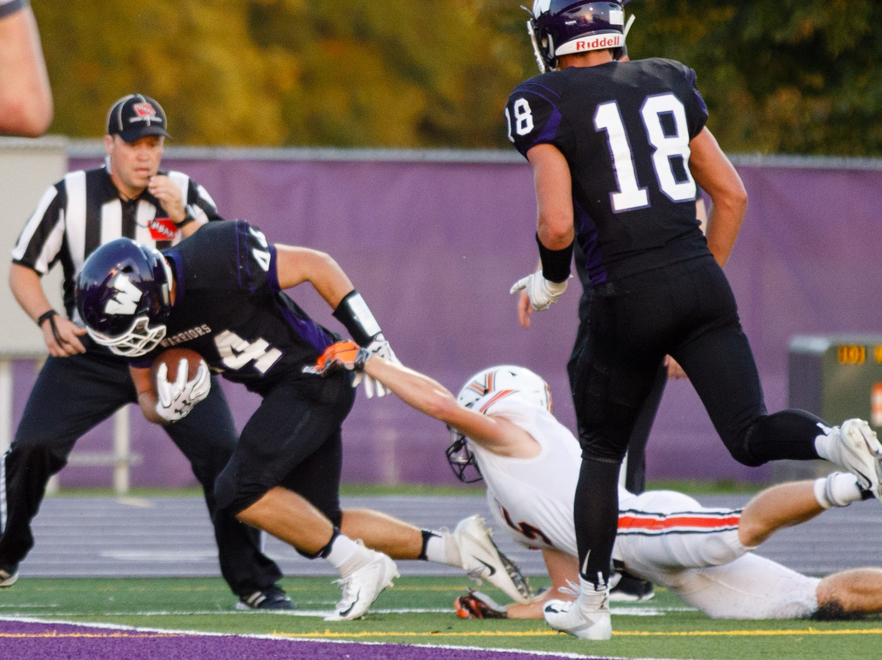 Waukee High School's Cole Romdall (44) punches in for a touchdown on Valley in the first quarter Friday, Sept. 14, 2018, at Waukee Stadium.