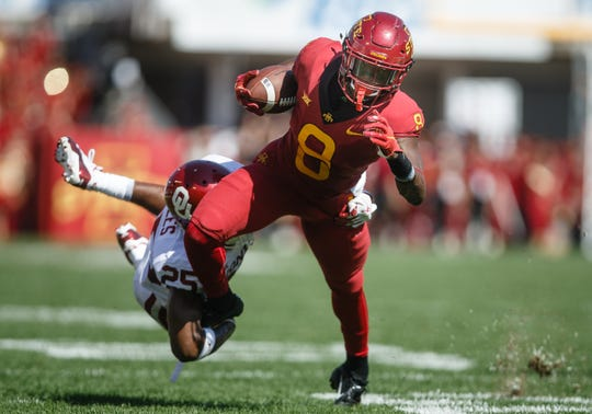 Iowa State's Deshaunte Jones (8) tries to get away from Oklahoma's Justin Broiles (25) during their football game at Jack Trice Stadium on Saturday, Sept. 15, 2018 in Ames. Oklahoma takes a 24-10 lead into halftime.