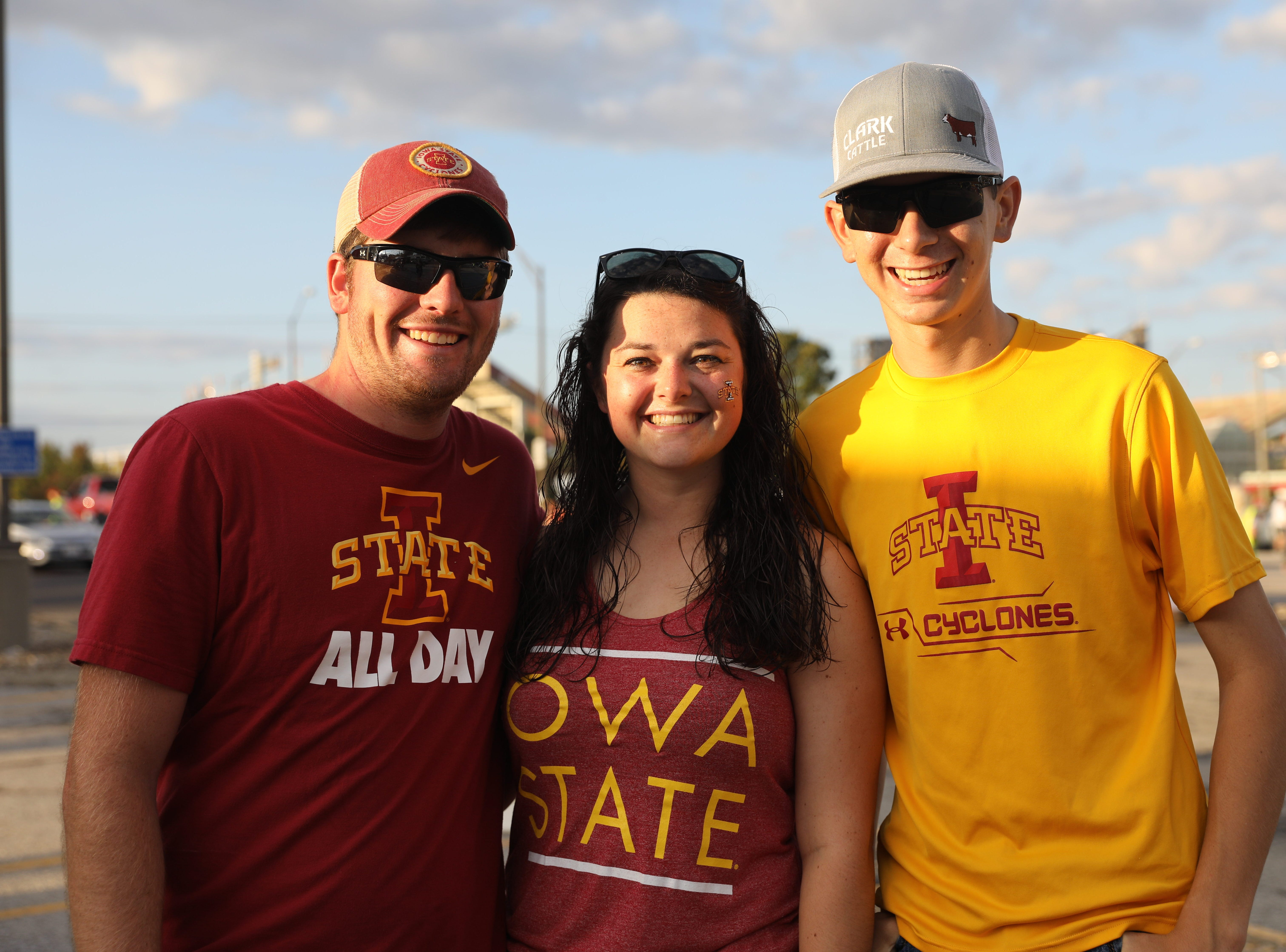 Andy Henderson, 23, of Albia (from left), Sarah Clark, 21, of Ames, and Curtis Clark, 16, of Albia, Saturday, Sept. 15, 2018, before the Iowa State football game against Oklahoma in Ames.