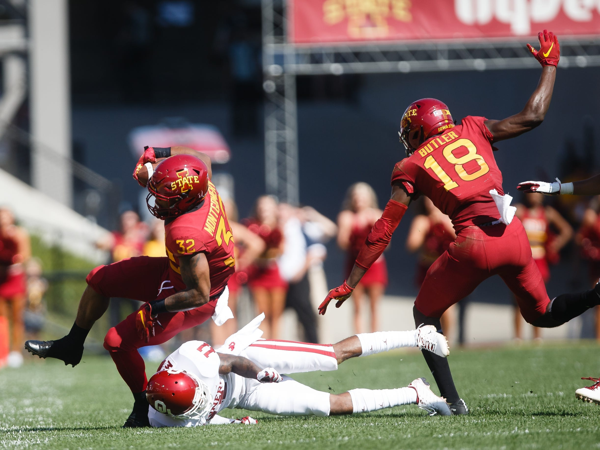 Iowa State's David Montgomery (32) is tackled by Oklahoma's Parnell Motley (11) during their football game at Jack Trice Stadium on Saturday, Sept. 15, 2018 in Ames. Oklahoma would go on to win 37-27.