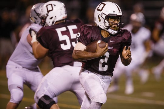 Dowling Catholic's Jayson Murray (2) rushes during their football game against Ankeny Centennial on Friday, Sept. 14, 2018 in West Des Moines. An 80 yard touchdown run with two minutes left in the game put Centennial up over Dowling 14-7 which is how the game ended.
