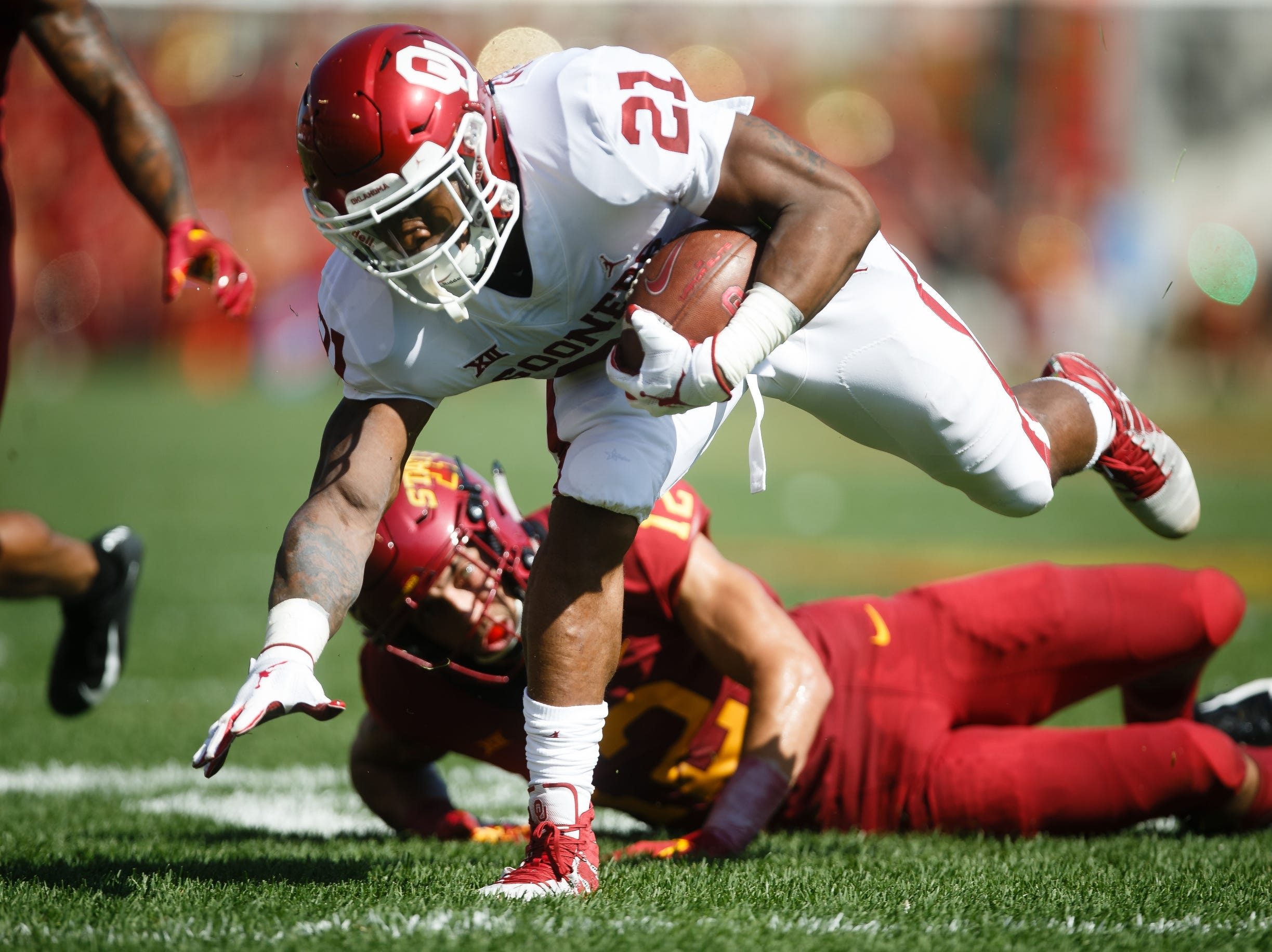 Oklahoma's Marcelias Sutton (21) gets away from Iowa State's Greg Eisworth (12) during their football game at Jack Trice Stadium on Saturday, Sept. 15, 2018 in Ames. Oklahoma would go on to win 37-27.