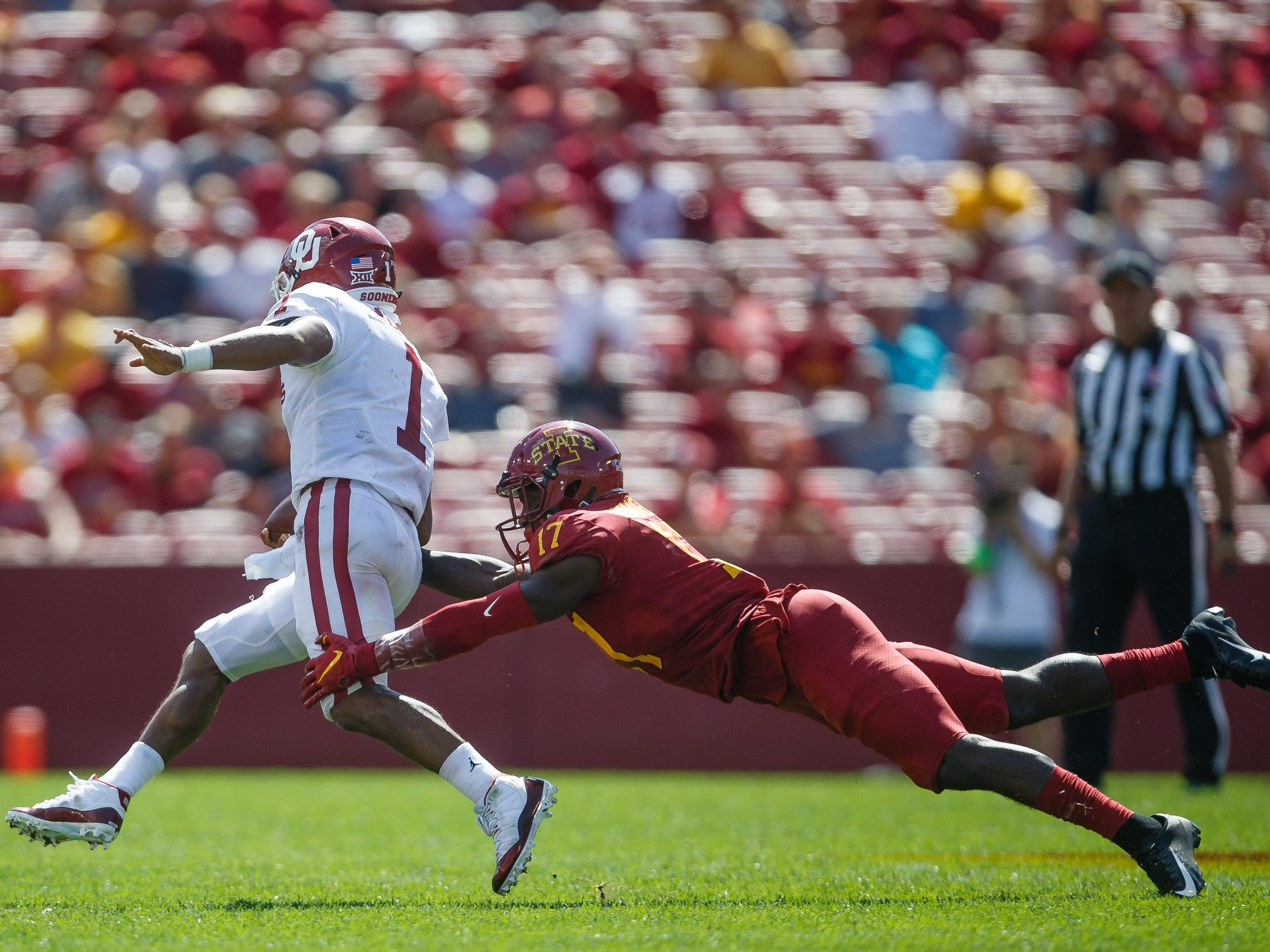Iowa State's Richard Bowens III (17) can't get ahold of Oklahoma's Kyler Murray (1) during their football game at Jack Trice Stadium on Saturday, Sept. 15, 2018 in Ames. Oklahoma would go on to win 37-27.