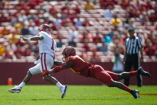 Oklahoma's Kyler Murray escapes from Iowa State's Richard Bowens III during a game at Jack Trice Stadium on Saturday, Sept. 15, 2018 in Ames. Oklahoma would go on to win 37-27. Three months later Murray was named the 2018 Heisman Trophy winner.