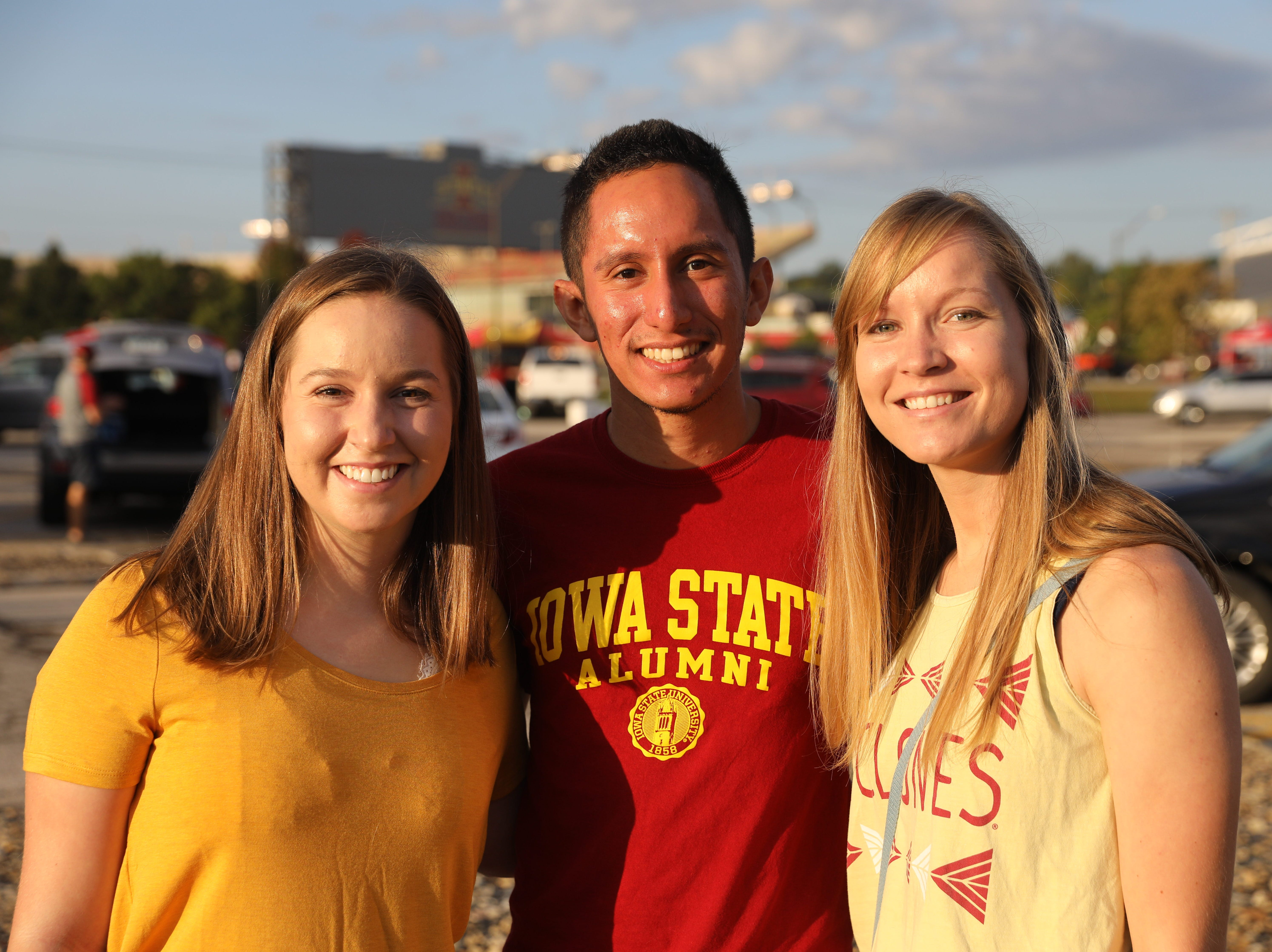 Emily Mickelson, 21, of Waukee (from left), Alberto Lara, 25, of West Des Moines, and Kylie Mickelson, 24, of Waukee, Saturday, Sept. 15, 2018, before the Iowa State football game against Oklahoma in Ames.
