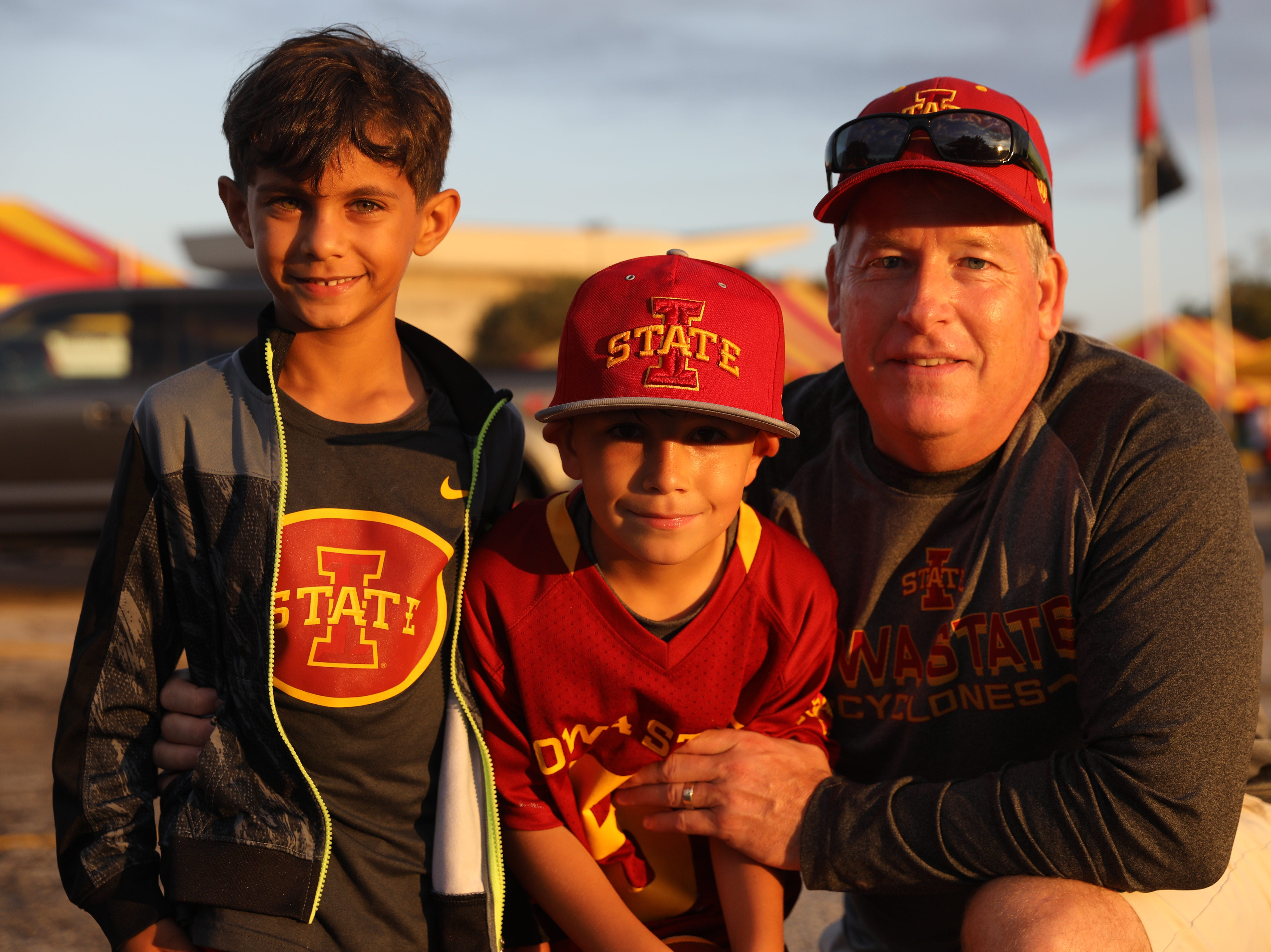 Aashir Jha, 7, (from left) Aiden Dale, 7, and Mike Dale, all of Hayward, Calif., Saturday, Sept. 15, 2018, before the Iowa State football game against Oklahoma in Ames.
