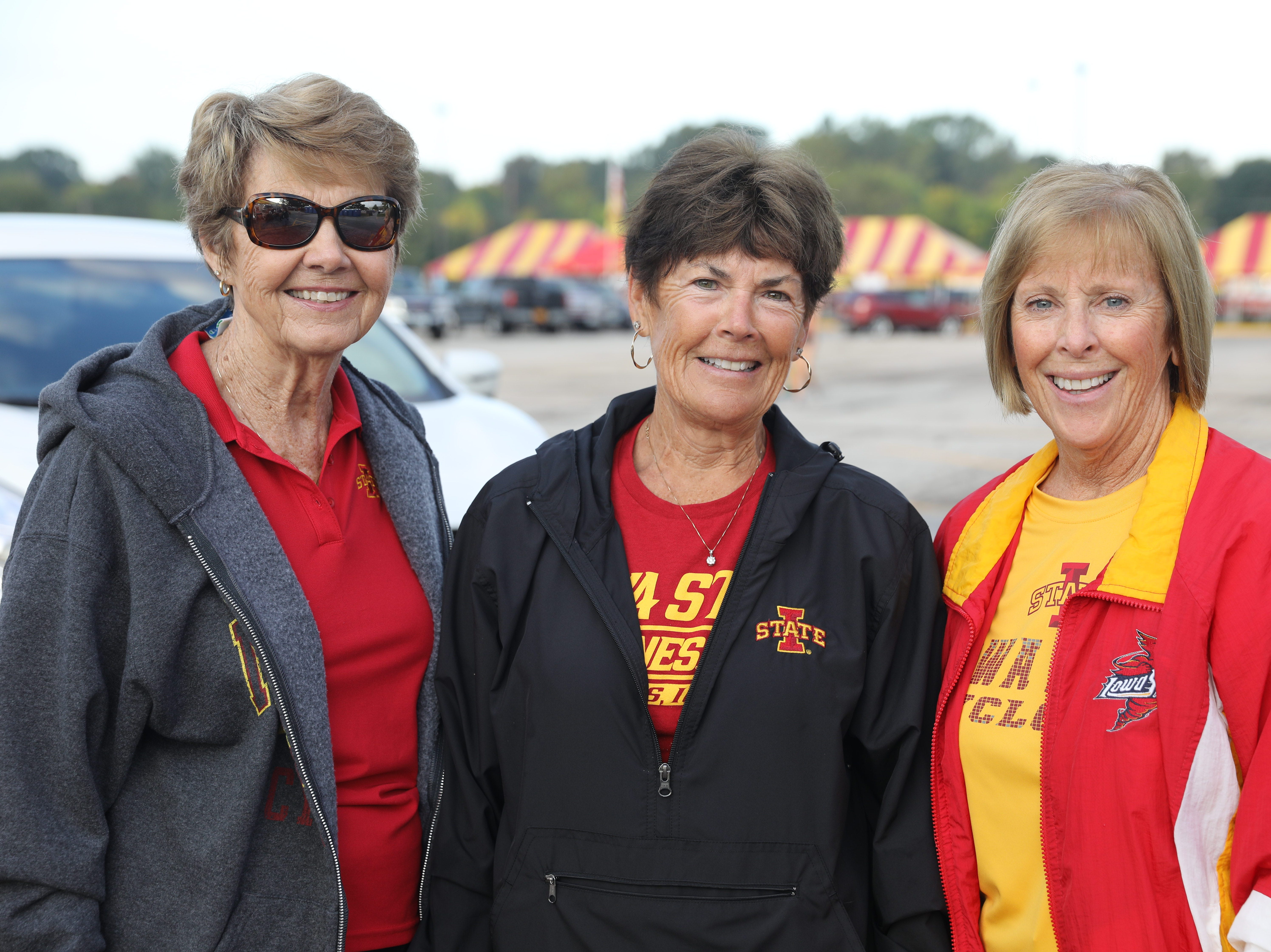 Laura Mattoon of Ankeny (from left), Nancy Heanthman of Ames, and Deedee Johnson of Okoboji, Saturday, Sept. 15, 2018, before the Iowa State football game against Oklahoma in Ames.
