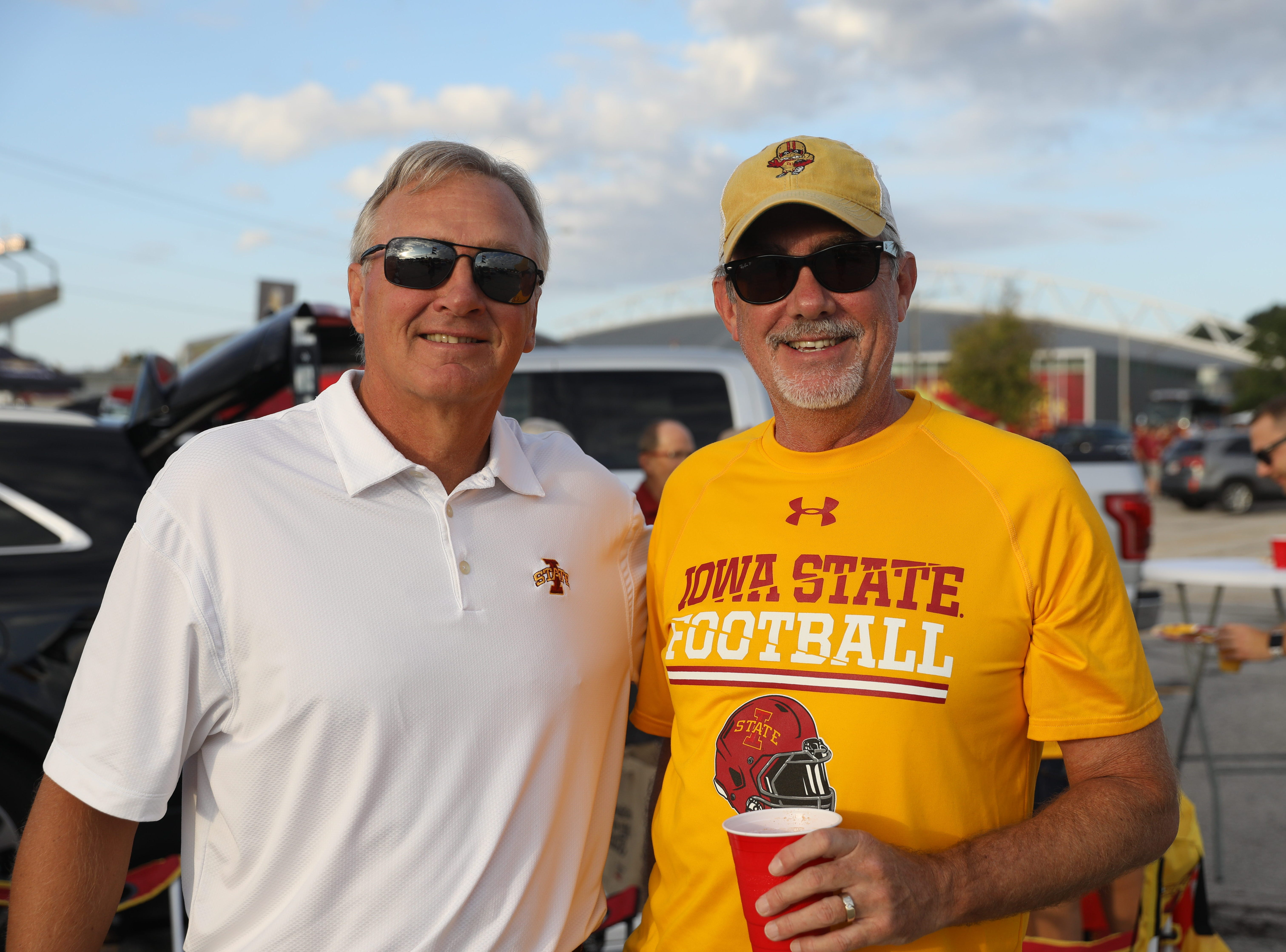 Craig Hansen (left) and Dave Green, both of Urbandale, Saturday, Sept. 15, 2018, before the Iowa State football game against Oklahoma in Ames.