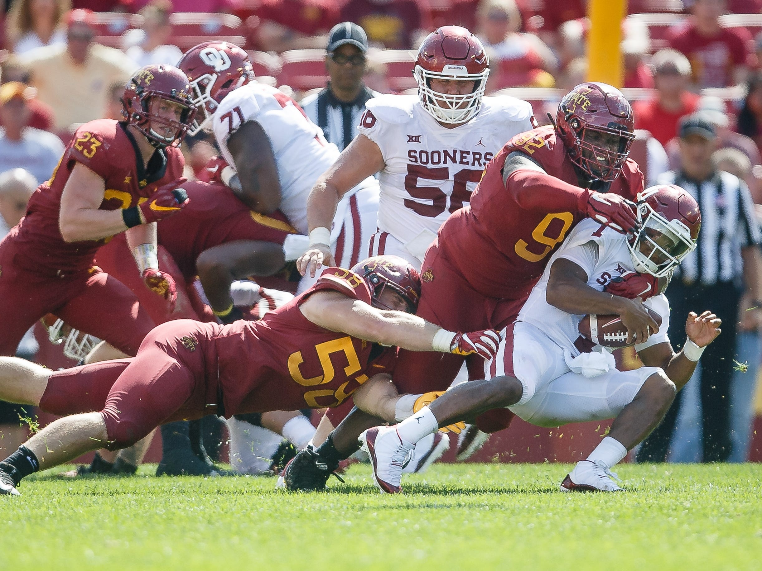 Iowa State's Jamahl Johnson (92) sacks Oklahoma's Kyler Murray (1) during their football game at Jack Trice Stadium on Saturday, Sept. 15, 2018 in Ames. Oklahoma would go on to win 37-27.