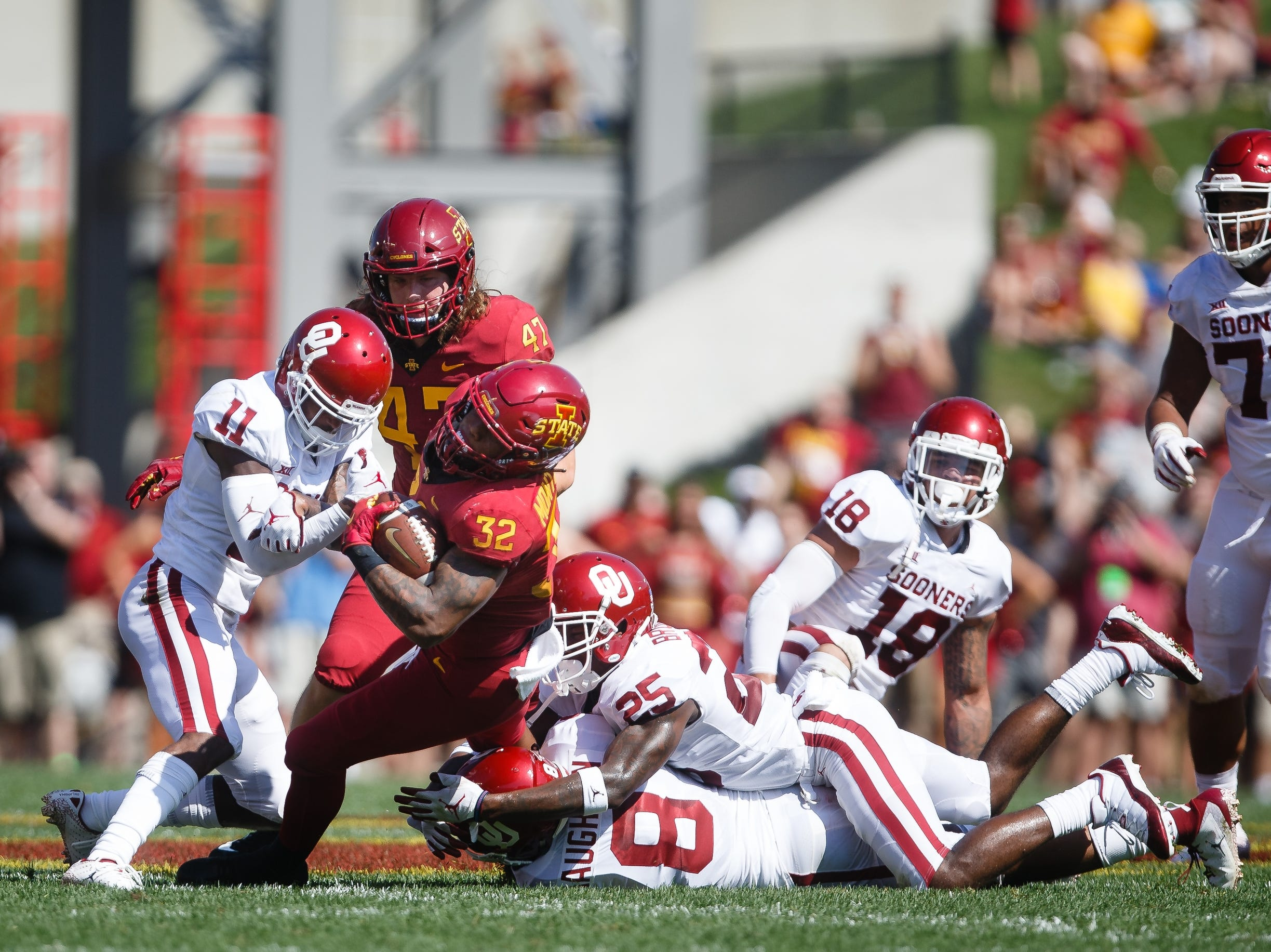 Iowa State's David Montgomery (32) rushes during their football game at Jack Trice Stadium on Saturday, Sept. 15, 2018 in Ames. Oklahoma would go on to win 37-27.