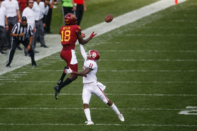 Iowa State's Hakeem Butler (18) makes a catch over Oklahoma's Parnell Motley (11) and would run it in for a touchdown to start the third quarter of their football game at Jack Trice Stadium on Saturday, Sept. 15, 2018 in Ames. Oklahoma would go on to win 37-27.