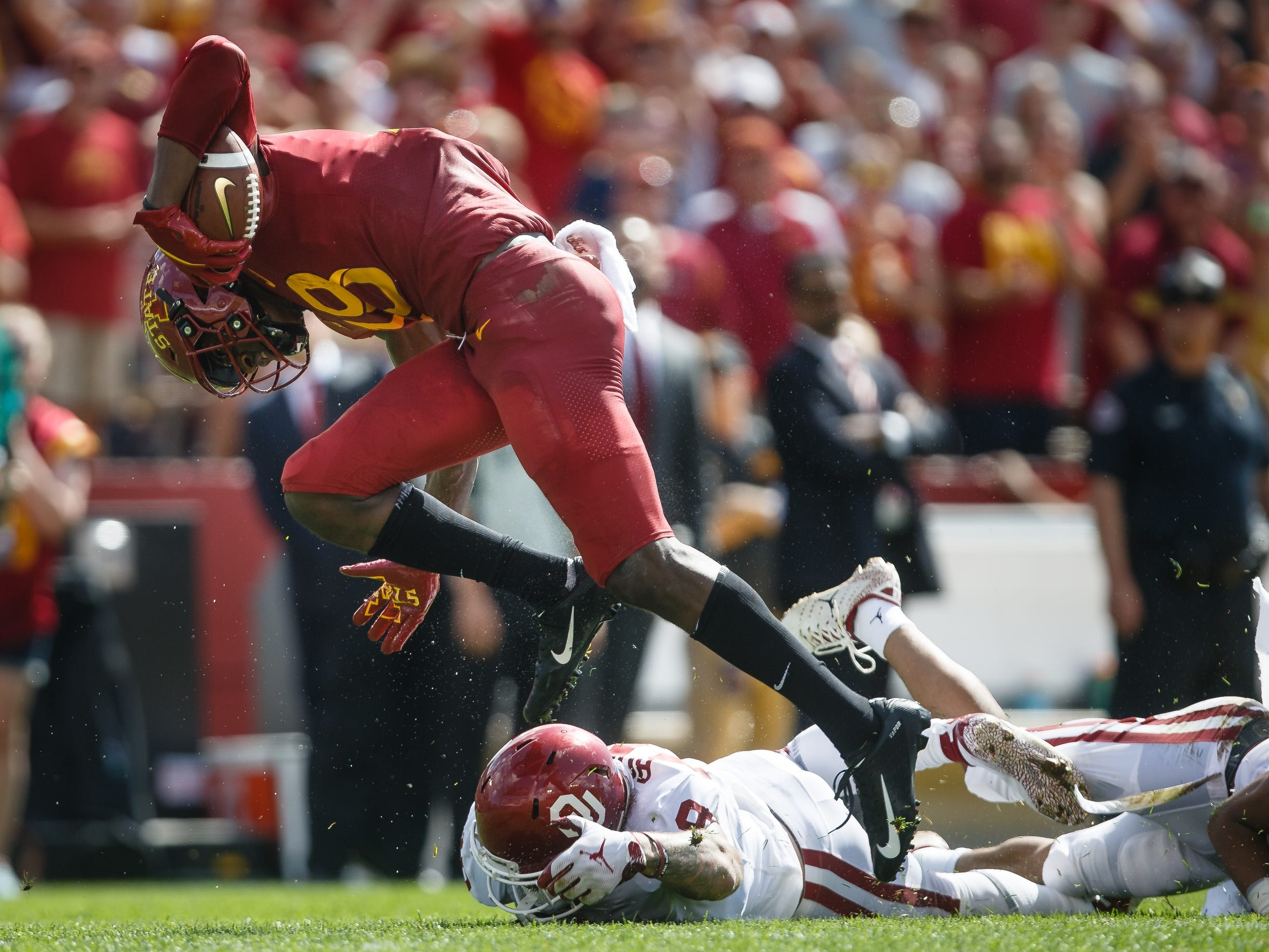 Iowa State's Hakeem Butler (18) breaks a tackle on his way to scoring a touchdown to tie the game at 10 during their football game against Oklahoma at Jack Trice Stadium on Saturday, Sept. 15, 2018 in Ames. Oklahoma takes a 24-10 lead into halftime.