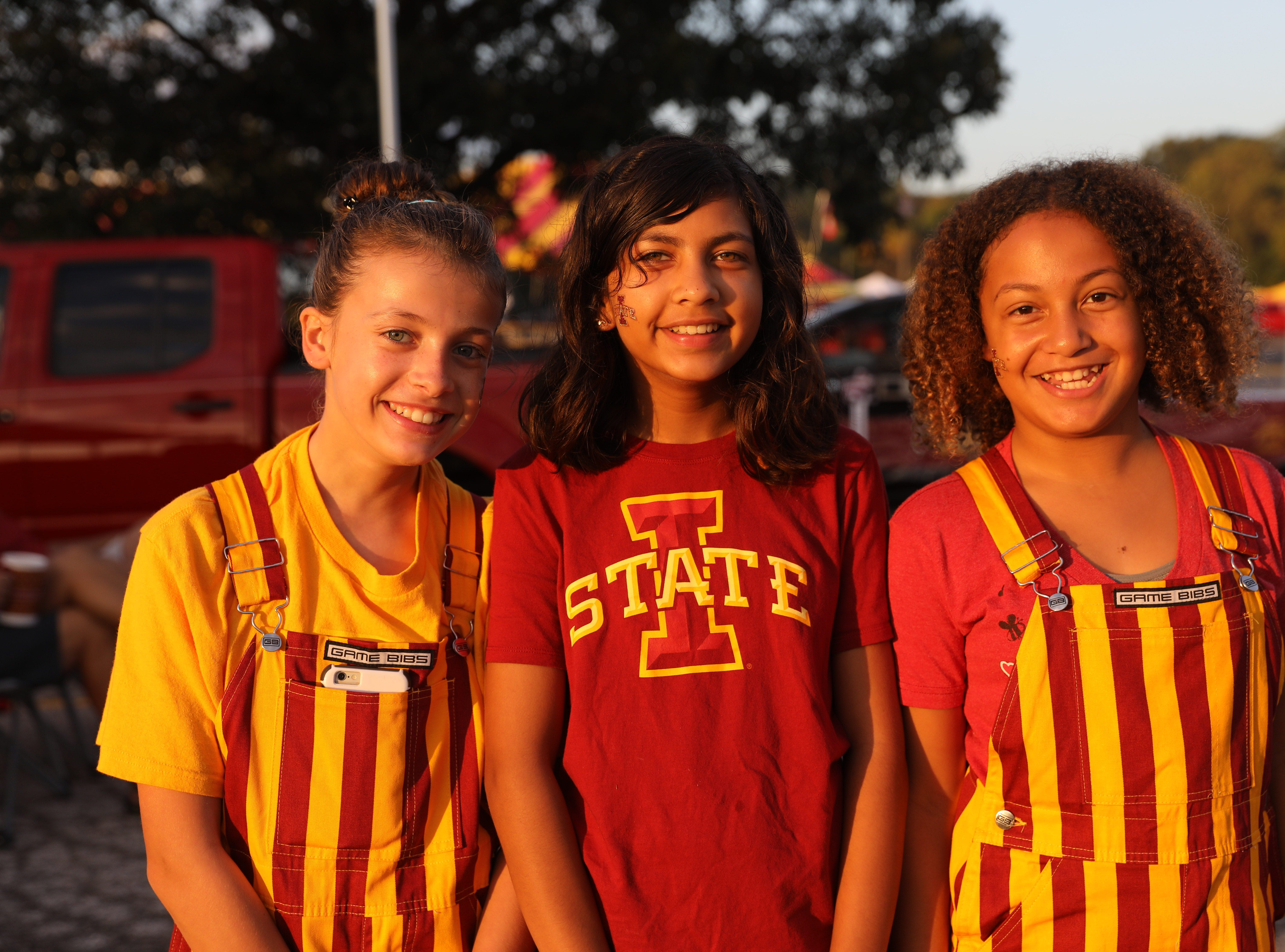 Ashlin Dale, 11, (from left) Risa Jha, 11, and Marley Brown, 12, all of Hayward, Calif. Saturday, Sept. 15, 2018, before the Iowa State football game against Oklahoma in Ames.