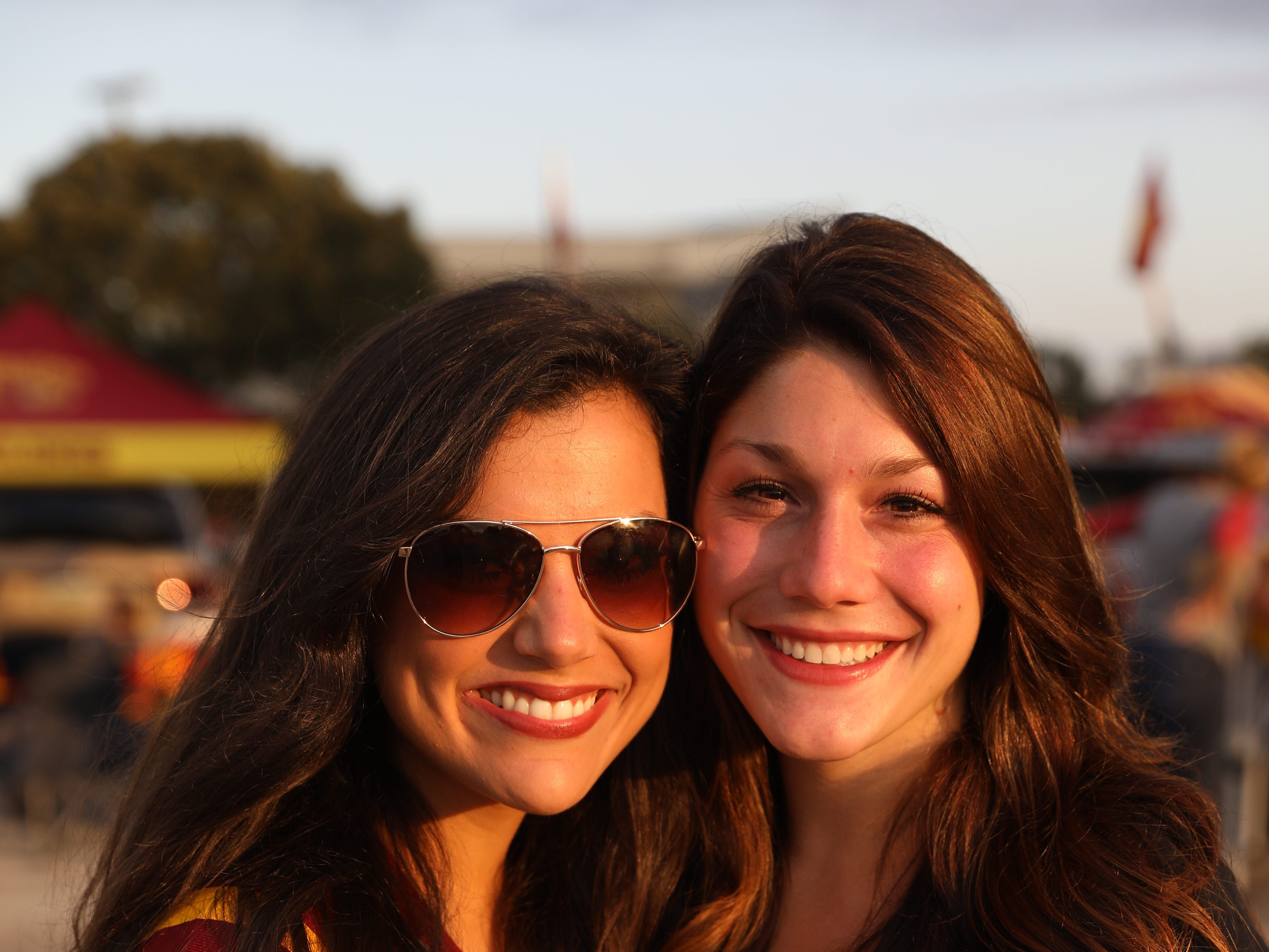 Lisa Vanderkamp, 25, (left) and Hannah Seeley, 24, both of Denver, Saturday, Sept. 15, 2018, before the Iowa State football game against Oklahoma in Ames.