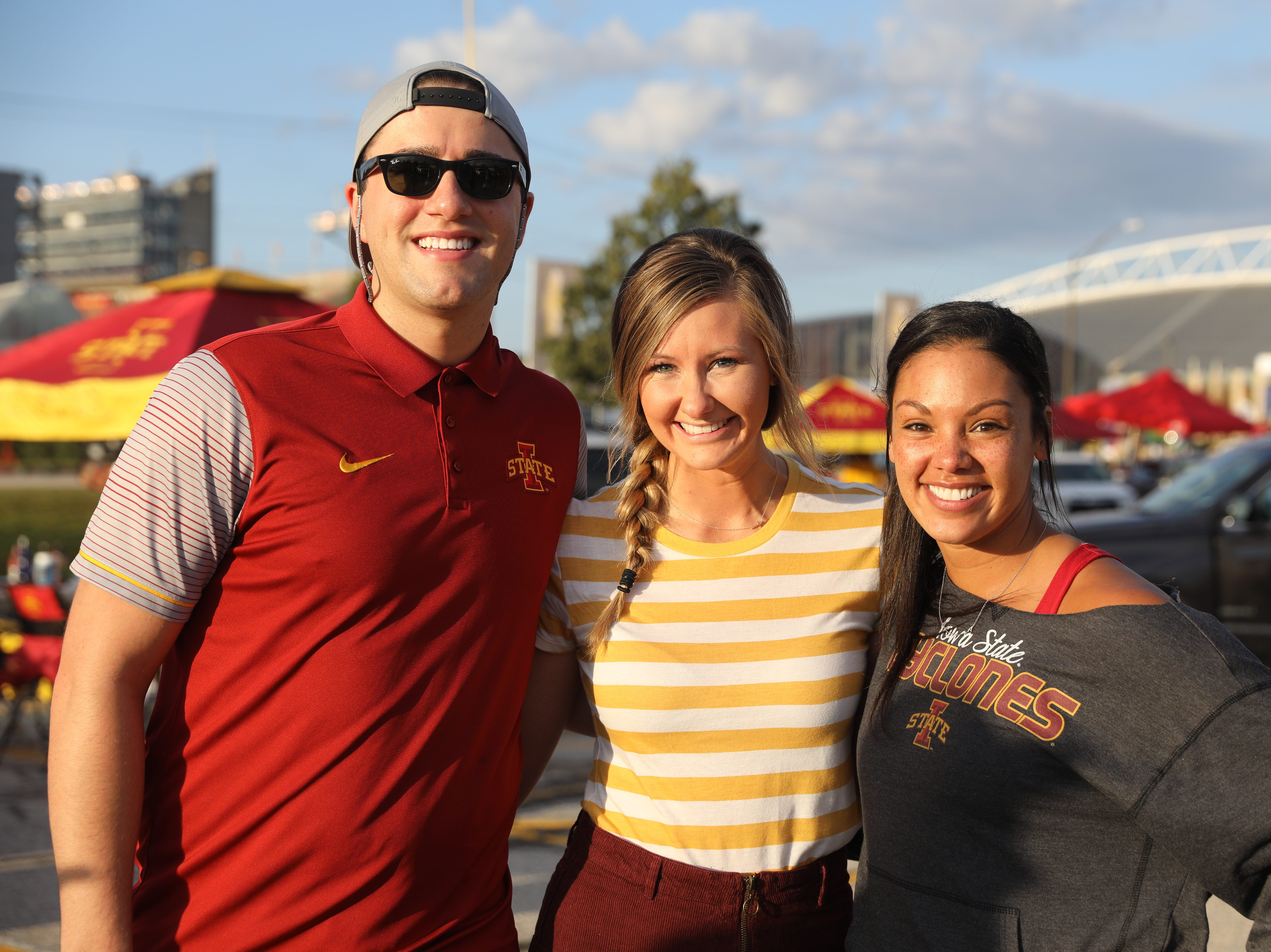Tony Thomas, 25, (from left) Holly Nelson, 26, both of West Des Moines, and Alex Hudson, 28, of Clive, Saturday, Sept. 15, 2018, before the Iowa State football game against Oklahoma in Ames.