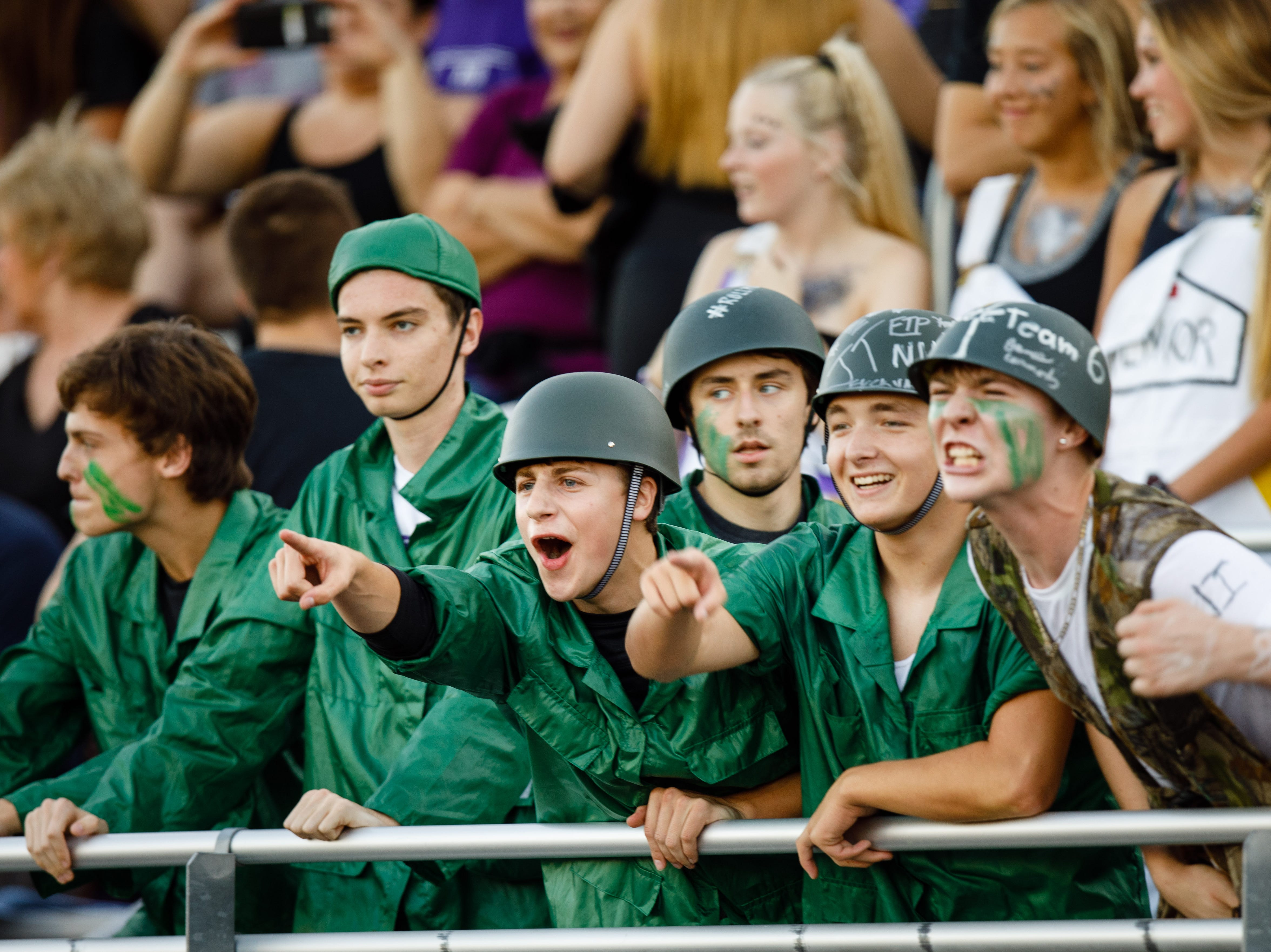 Waukee High School fans cheer as they get ready to play West Des Moines Valley Friday, Sept. 14, 2018, at Waukee Stadium.