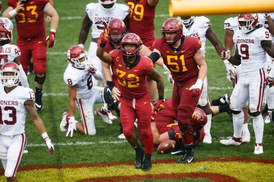 Iowa State's David Montgomery (32) celebrates his touchdown during their football game at Jack Trice Stadium on Saturday, Sept. 15, 2018 in Ames. Oklahoma would go on to win 37-27.
