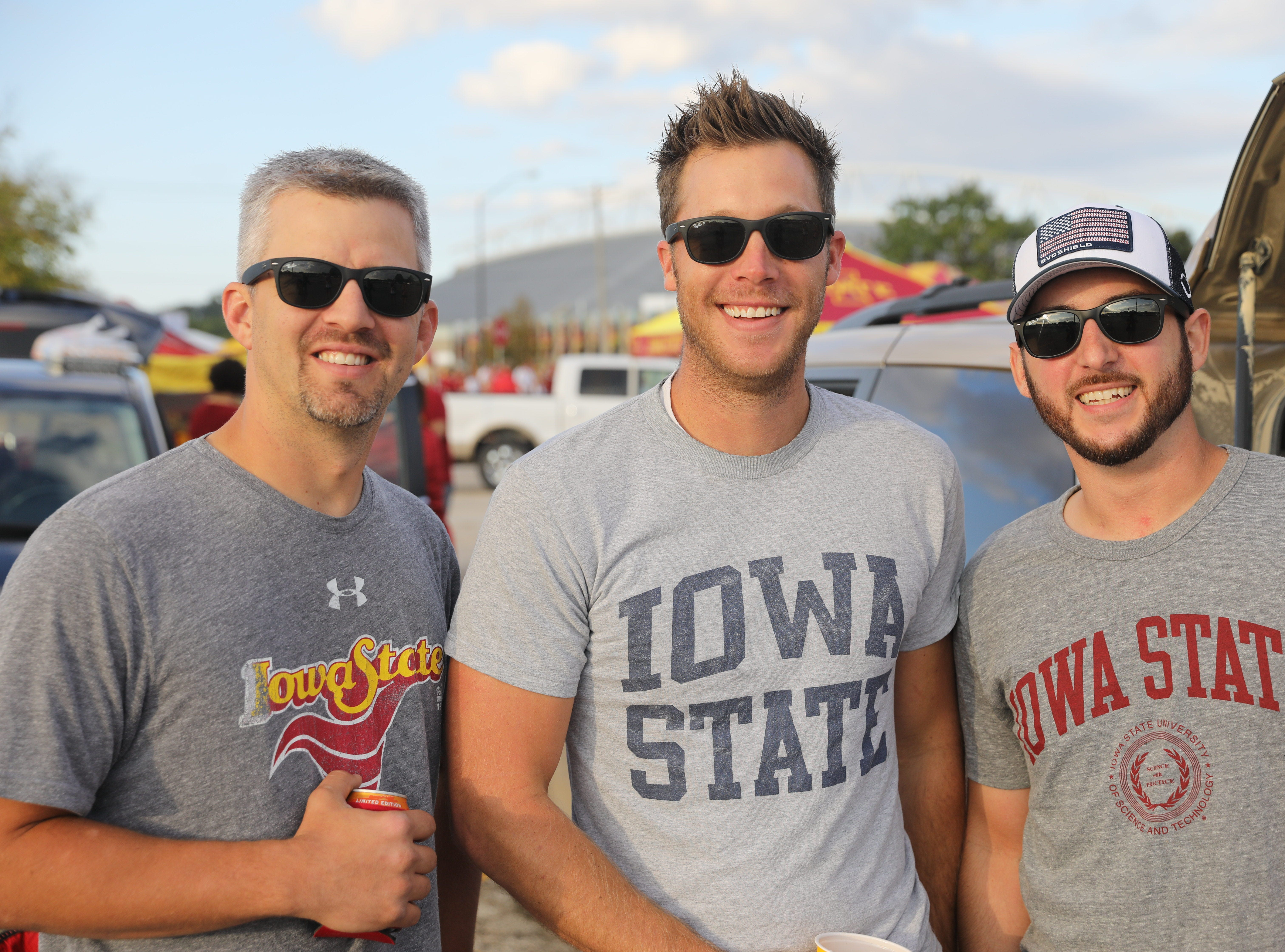Michael Miller, 34, of Osceola (from left), Ben Wallace, 33, of Lake View, and Adam Warnemunde, 33, of Calamus Saturday, Sept. 15, 2018, before the Iowa State football game against Oklahoma in Ames.