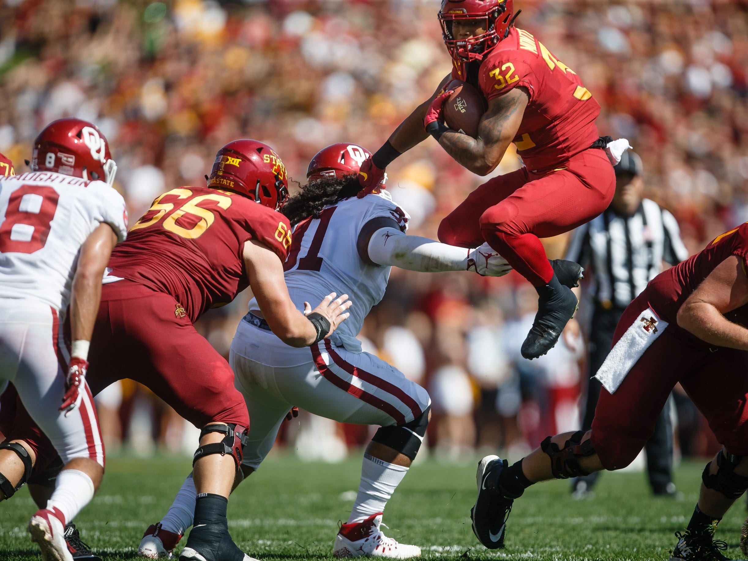 Iowa State's David Montgomery (32) jumps over the line during their football game against Oklahoma at Jack Trice Stadium on Saturday, Sept. 15, 2018 in Ames. Oklahoma takes a 24-10 lead into halftime.