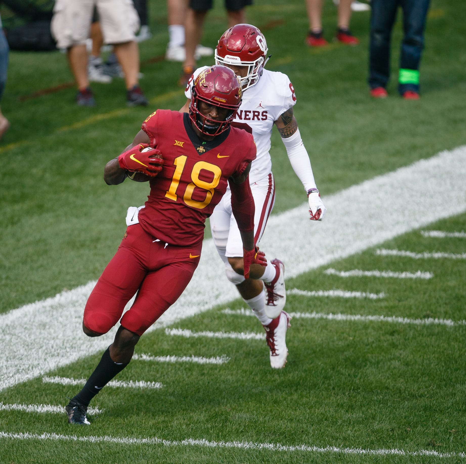 Iowa State's Hakeem Butler (18) breaks a tackle...