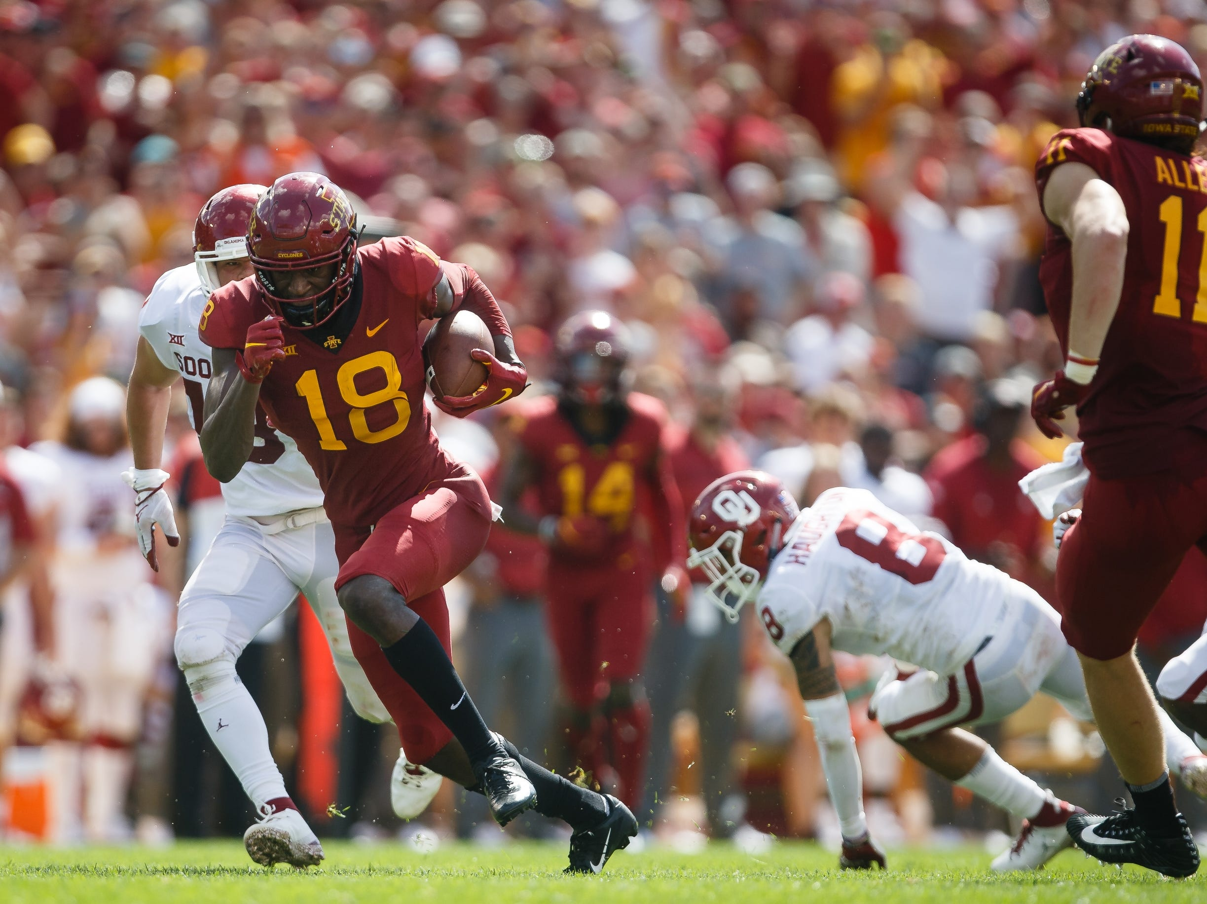 Iowa State's Hakeem Butler (18) breaks a tackle after catching a pass and runs it in for a touchdown during their football game at Jack Trice Stadium on Saturday, Sept. 15, 2018 in Ames. Oklahoma would go on to win 37-27.